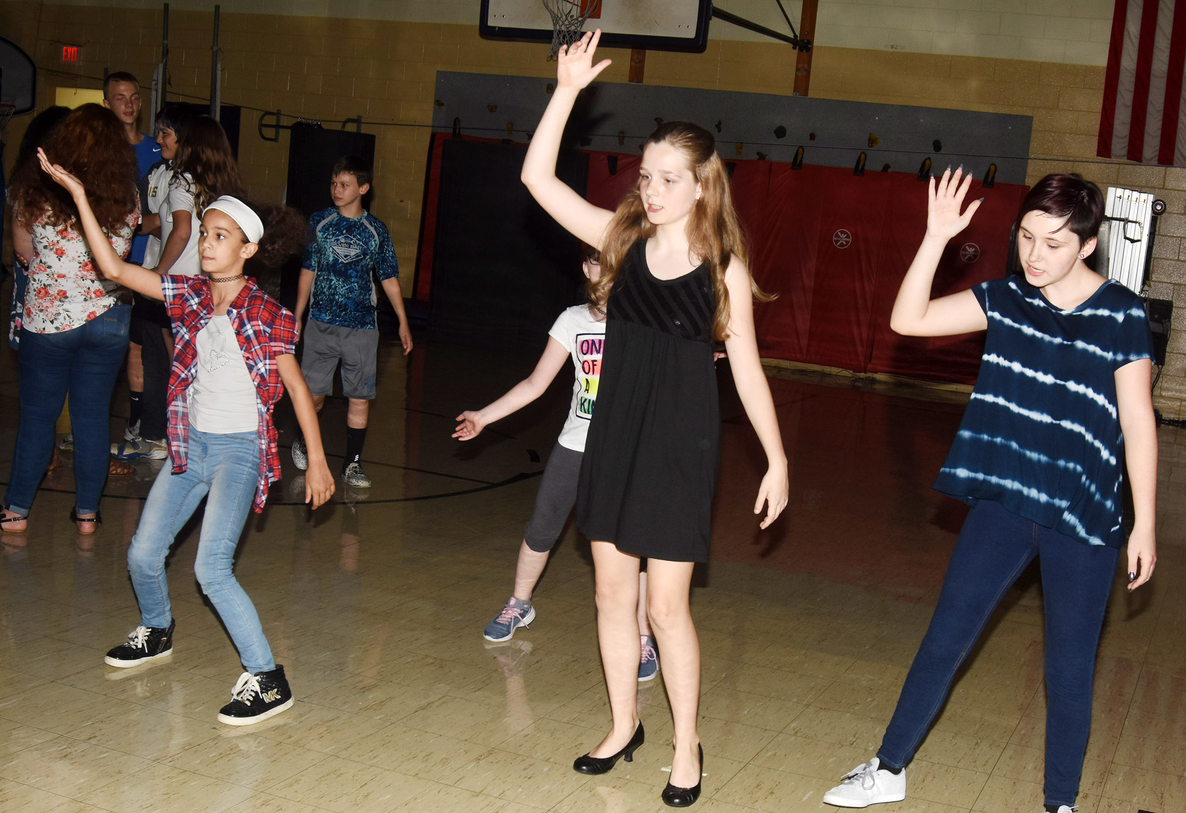 From left, CMS sixth-grader Mackenzie Negron and seventh-graders Mallory Parker and K.J. Forbis dance.