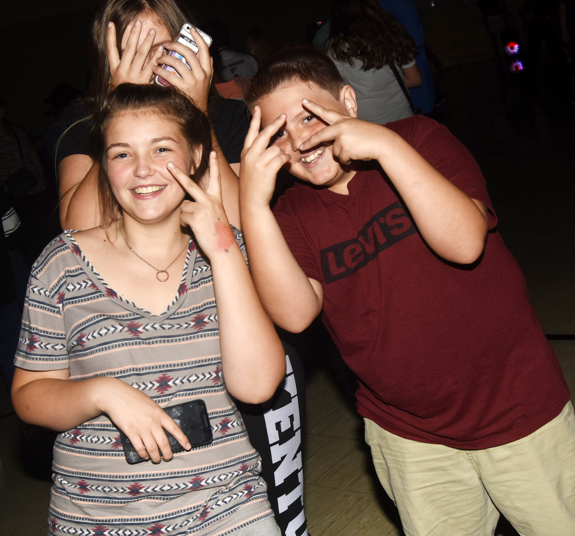CMS seventh-graders, from left, Angel Walker, Grace Tungate and Nathan Ray have fun at the dance.