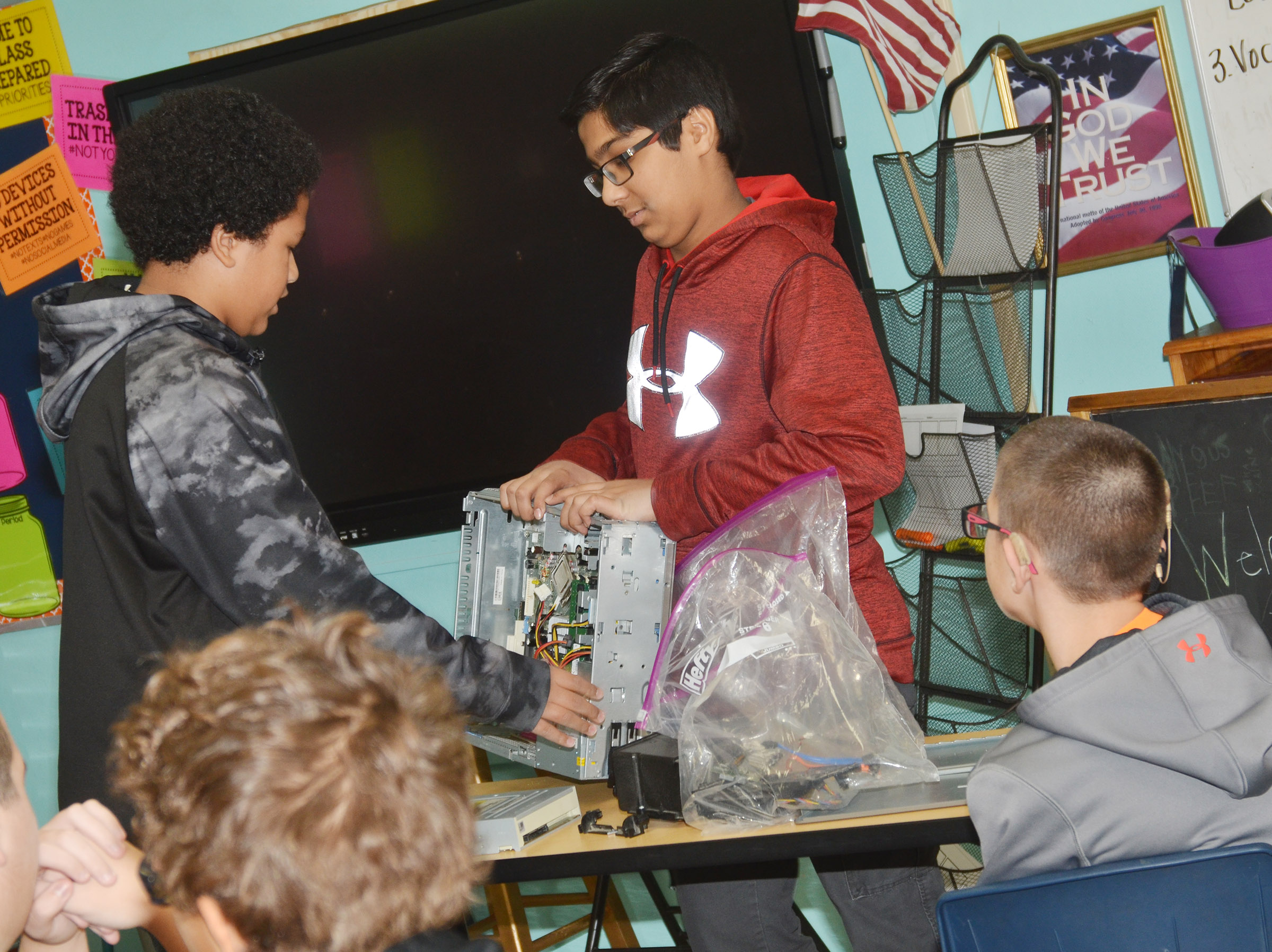 CMS eighth-graders Tezon Mitchell, at left, and Yash Patel talk about how to build a computer.