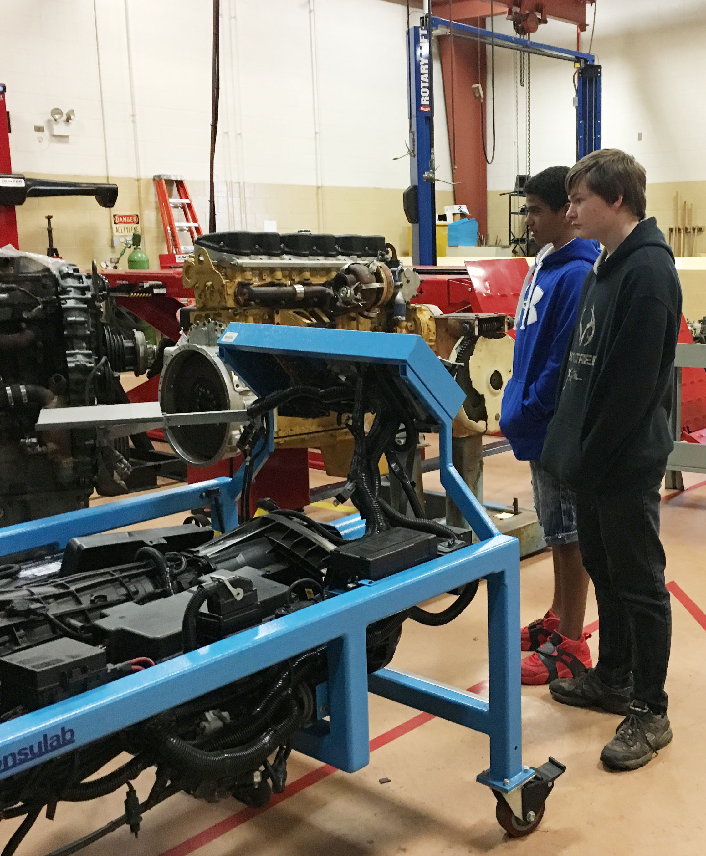 CMS eighth-grader Deion Harris, at left, and seventh-grader William Walker tour Elizabethtown Community & Technical College.