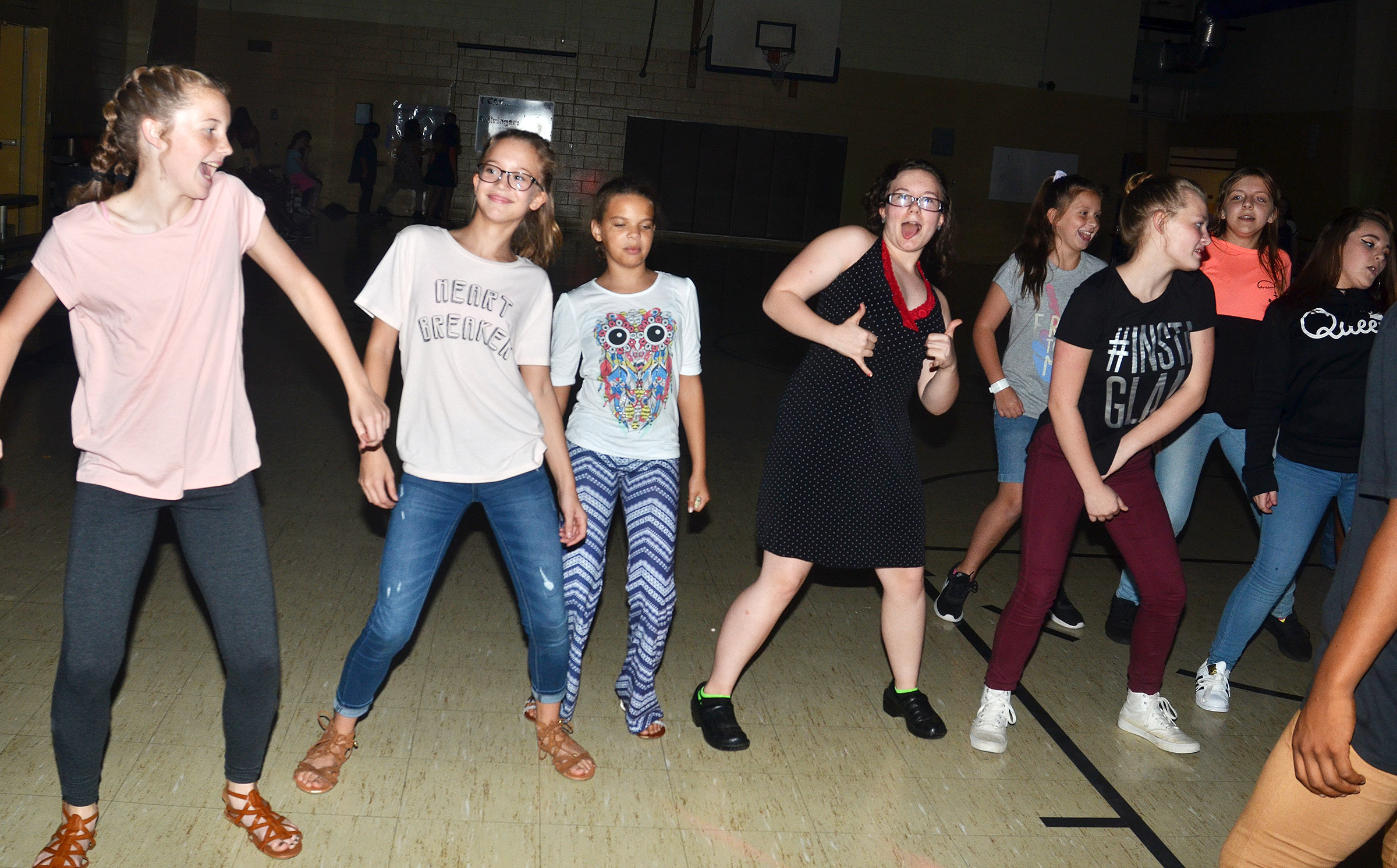 CMS students have fun dancing together.