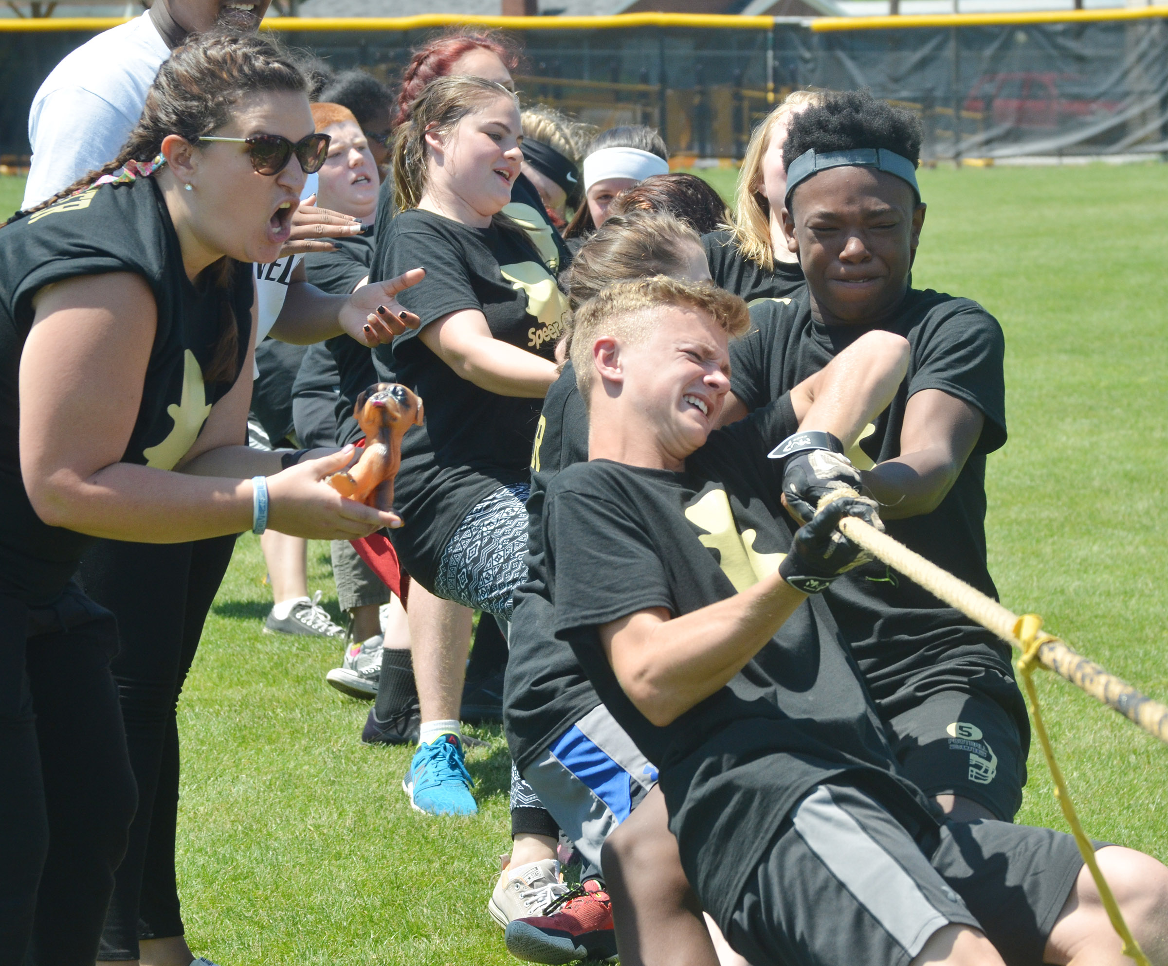 CMS eighth-grade teacher Robbilyn Speer cheers for her students as they compete in tug of war.
