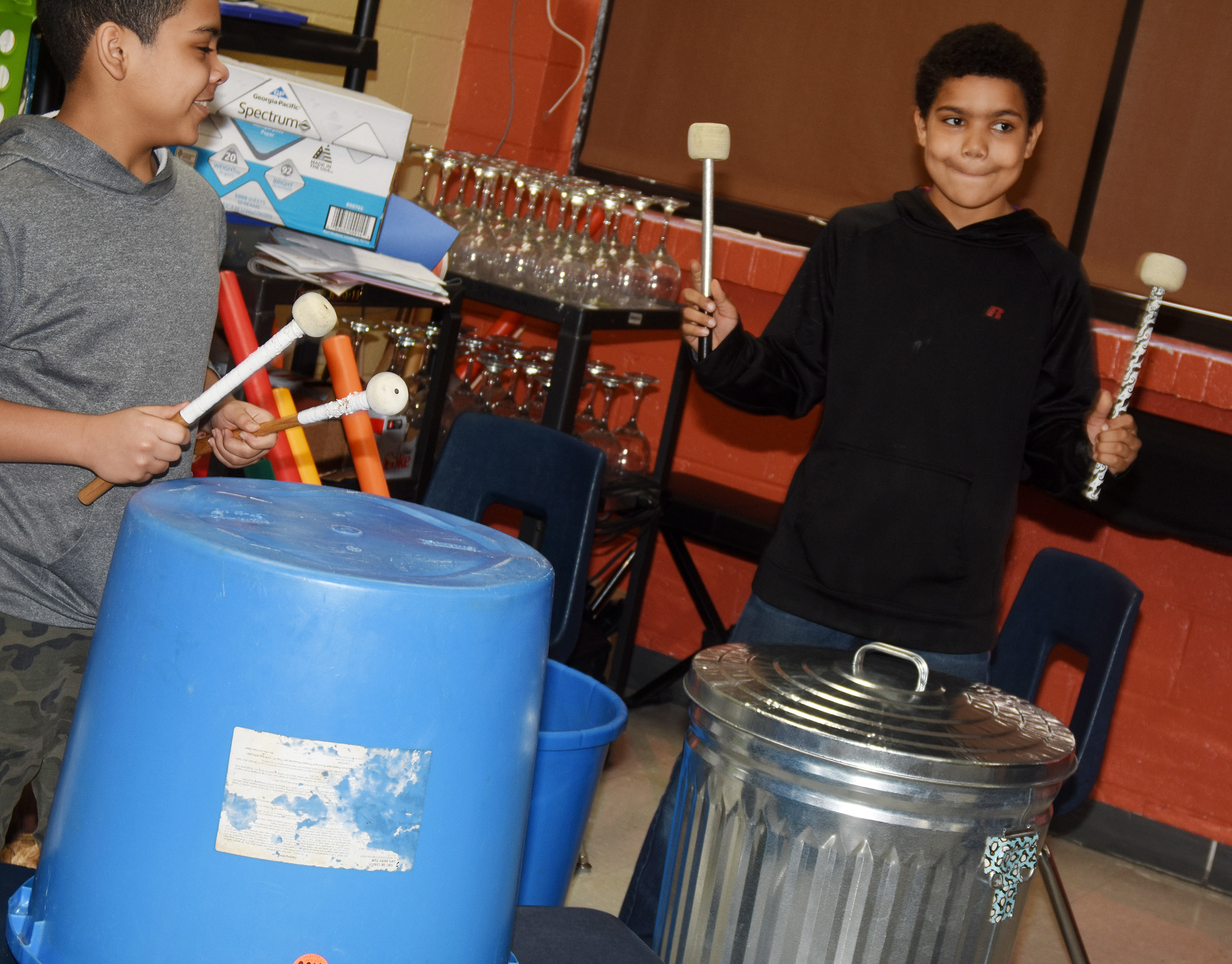 "CMS sixth-graders Diego Noyola, at left, and Tashaun Hart play ""Believer"" on the drums and trashcan."
