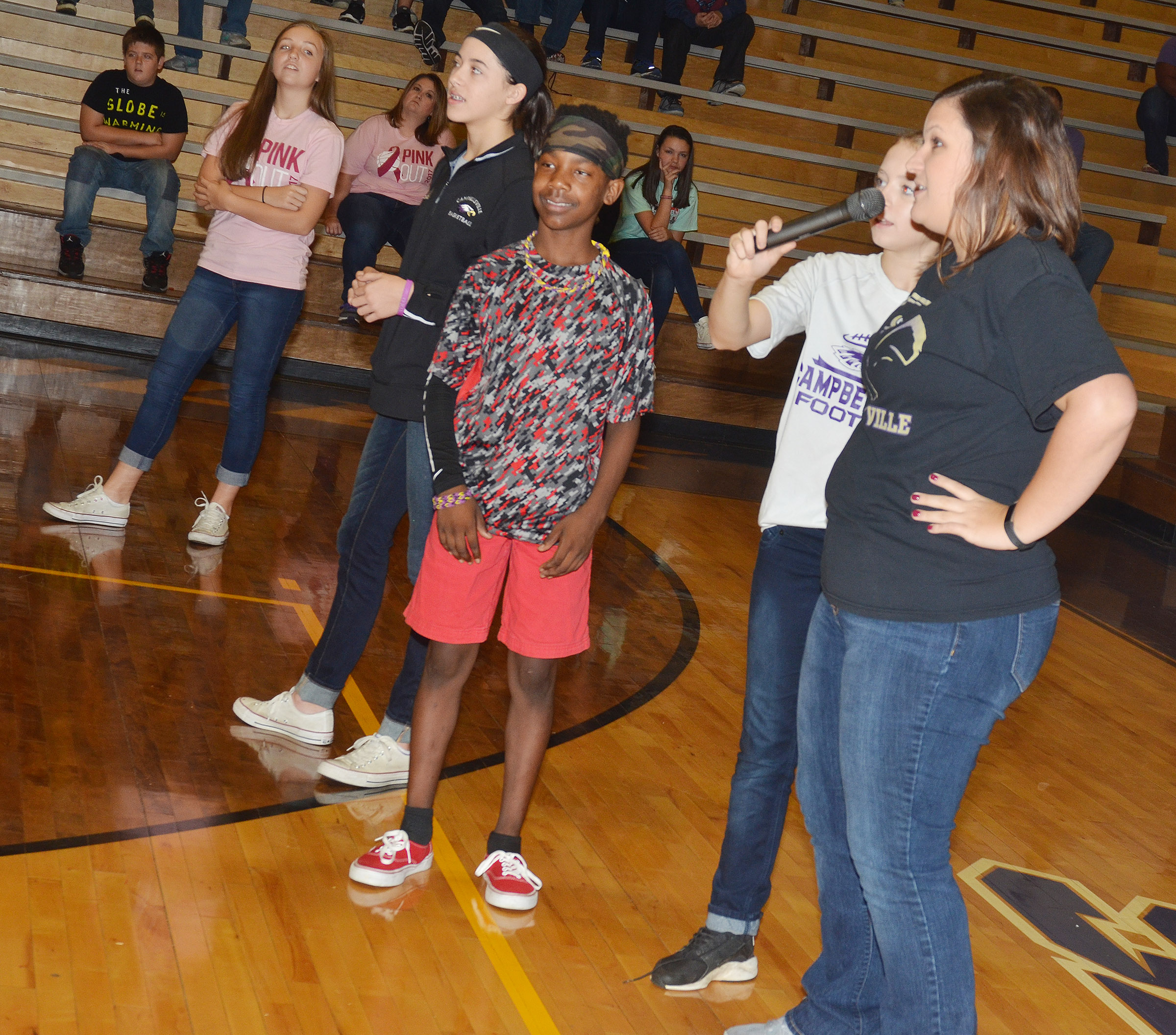 CMS eighth-grader teacher Robbilyn Speer gives directions in a game of Simon Says.