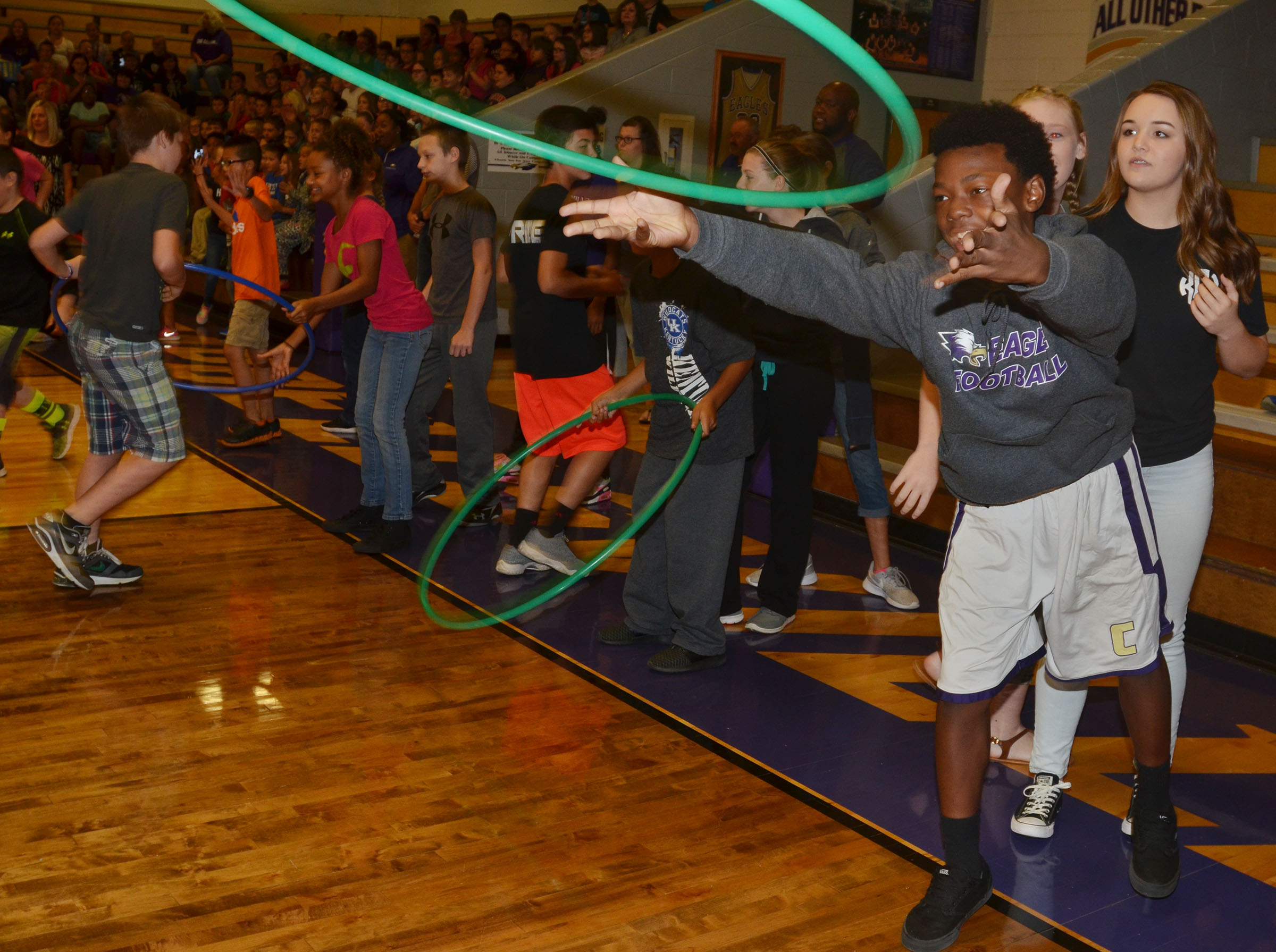 CMS eighth-grader Sae'von Buckner throws a hula-hoop in the human ring toss game.