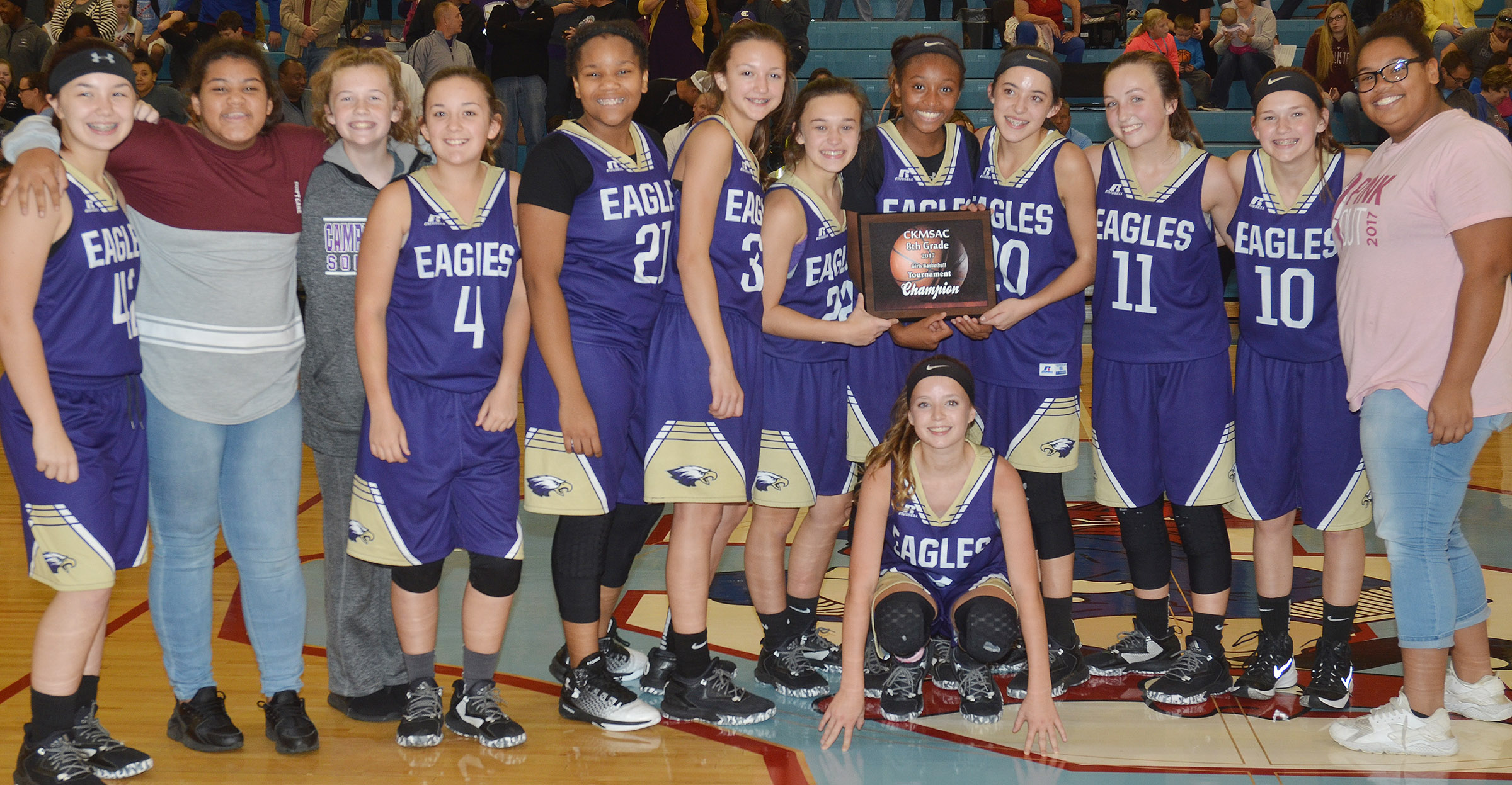 Campbellsville Middle School girls' eighth-grade basketball team recently won its first Central Kentucky Middle School Athletic Conference tournament championship title in 20 years. In front is eighth-grader Rylee Petett. Back, from left, eighth-grader Olivia Fields, seventh-graders Asia Barbour, Dakota Slone, Briana Davis, Antaya Epps and Bri Hayes, eighth-graders Tayler Thompson, Bri Gowdy, Kaylyn Smith and Lainey Watson, seventh-grader BreAnna Humphress and eighth-grader Brae Washington.