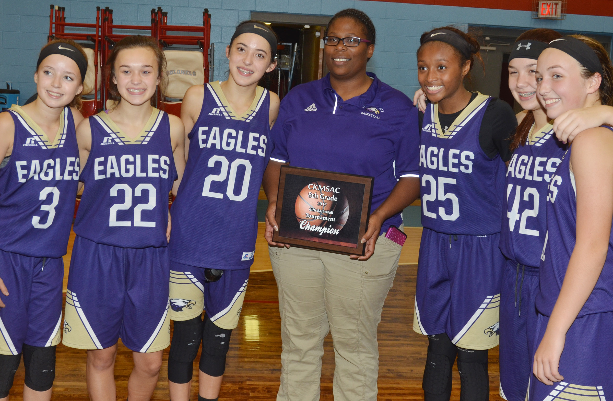 Campbellsville Middle School girls' eighth-grade basketball team recently won its first Central Kentucky Middle School Athletic Conference tournament championship title in 20 years. From left are eighth-graders Rylee Petett, Tayler Thompson and Kaylyn Smith, head coach Tiarra Cecil and eighth-graders Bri Gowdy, Olivia Fields and Lainey Watson.
