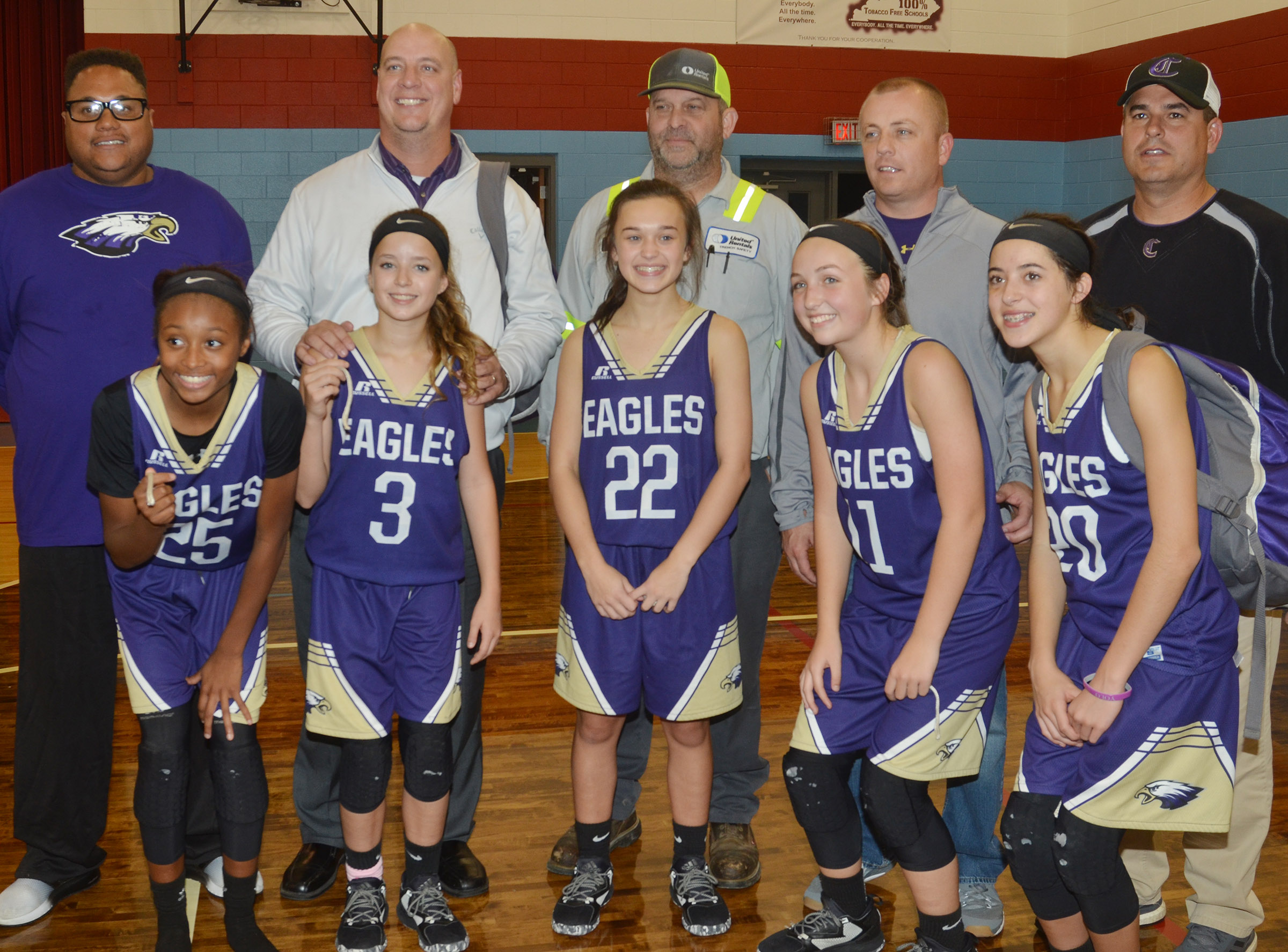 Campbellsville Middle School girls' eighth-grade basketball team recently won its first Central Kentucky Middle School Athletic Conference tournament championship title in 20 years. Above, eighth-grade players pose with their fathers. From left are Bri Gowdy and her father Bronson, Rylee Petett and her father David, Tayler Thompson and her father Greg, Lainey Watson and her father Jeff and Kaylyn Smith and her father Kirby.