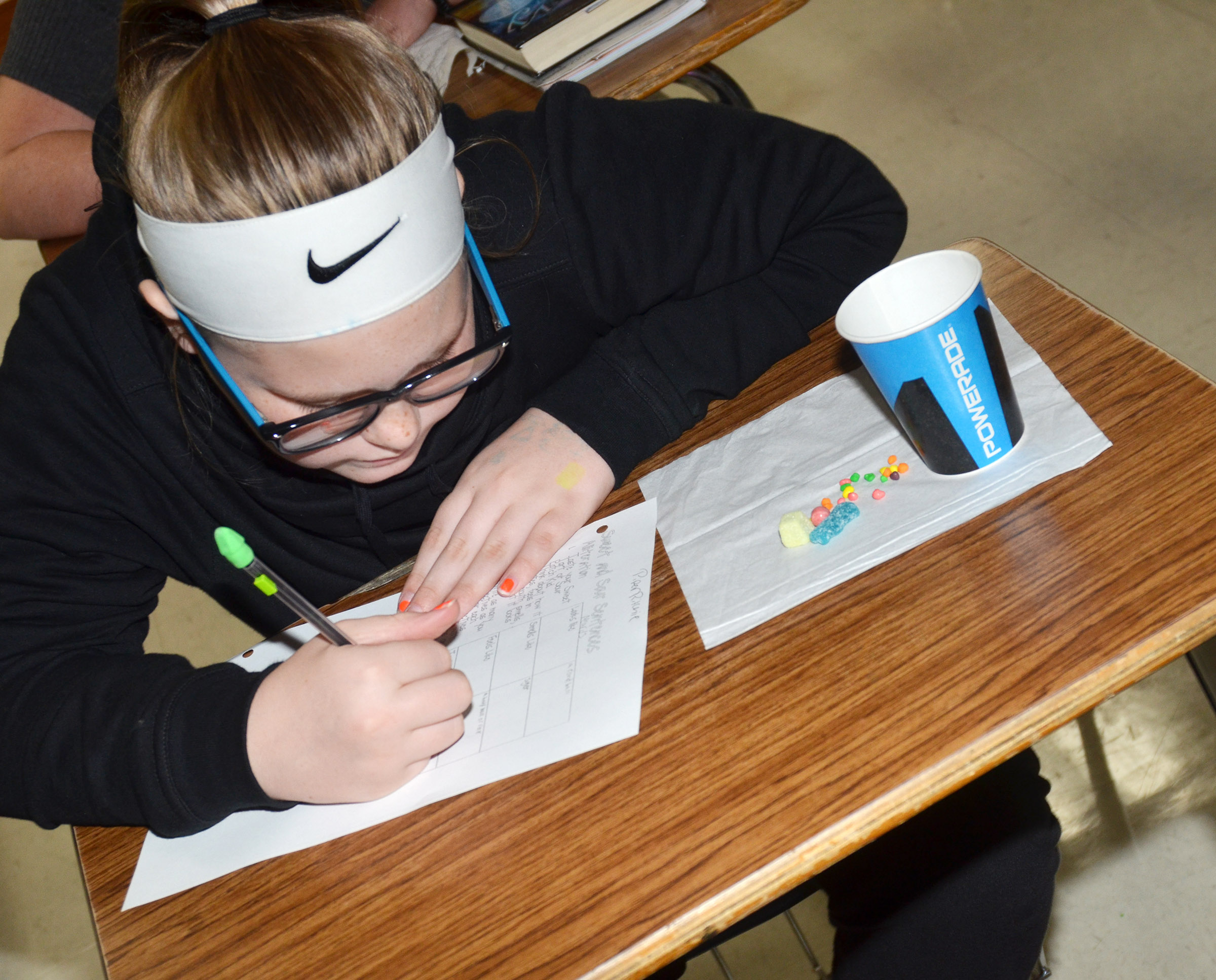 CMS sixth-grader Piper Ritchie uses alliterations and similes to describe her sweet and tart candies.