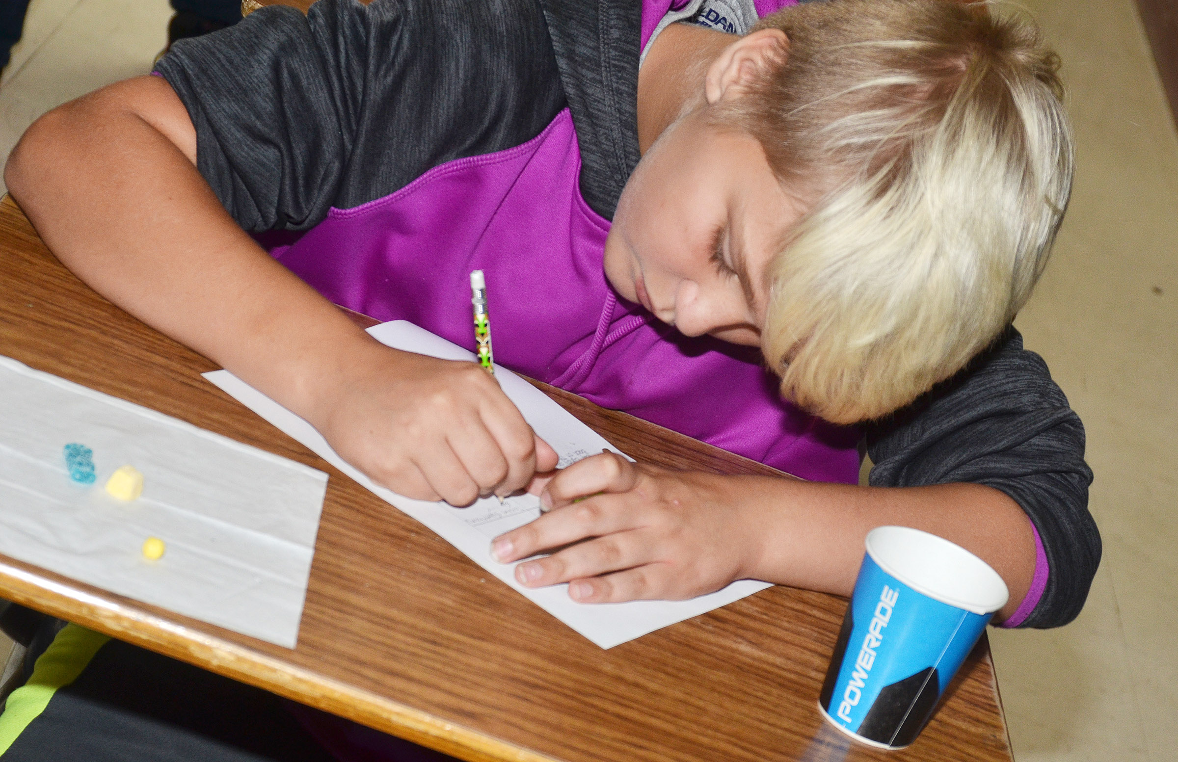 CMS sixth-grader Dakota Tungate uses alliterations and similes to describe his sweet and tart candies.