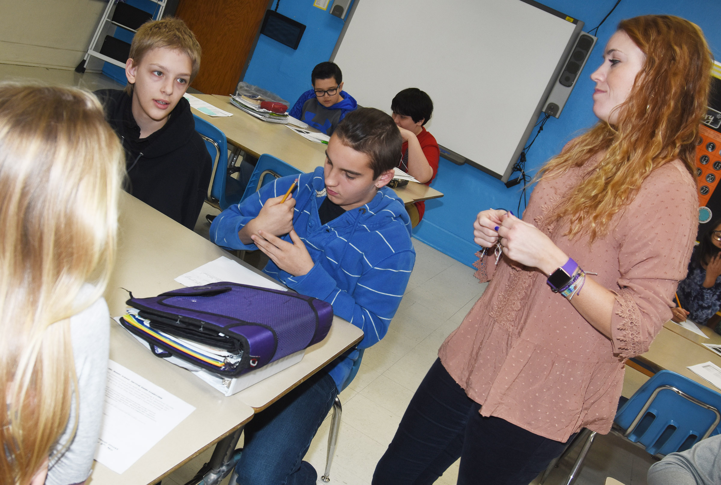 "CMS sixth-grade teacher LeeAnn Grider talks to leadership students Jacob Releford, at left, and Jordan Gabehart about what she needs to know to ""survive"" at her new school."