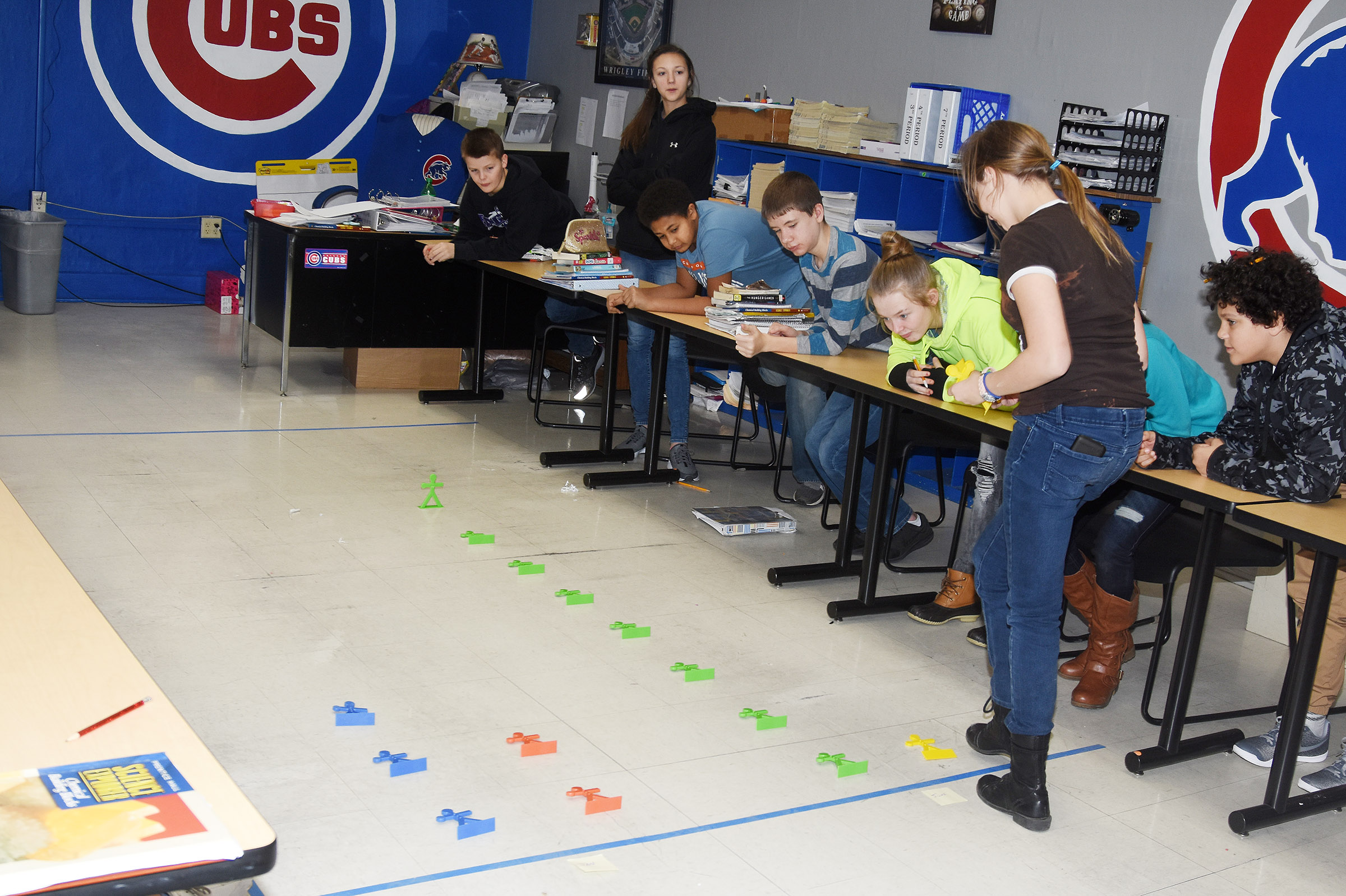 CMS seventh-grader Forever Tungate maps data on a life-size graph.