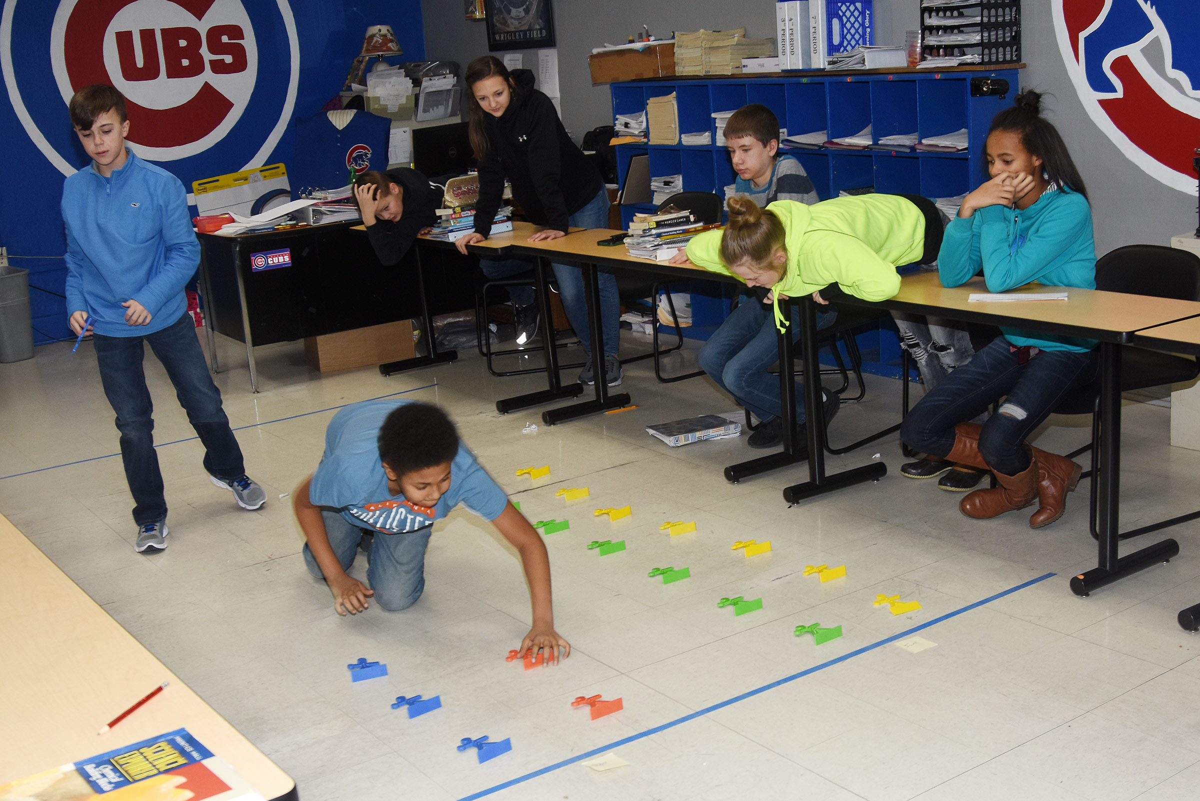 CMS seventh-graders Chase Hord, at left, and Ronin Smith map data on a life-size graph.