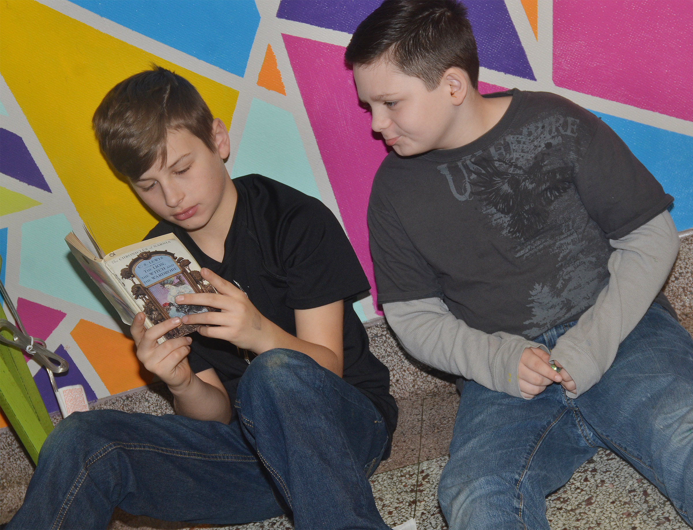 CMS fifth-graders Jaxon Sidebottom, at left, and Gregory Burton read.