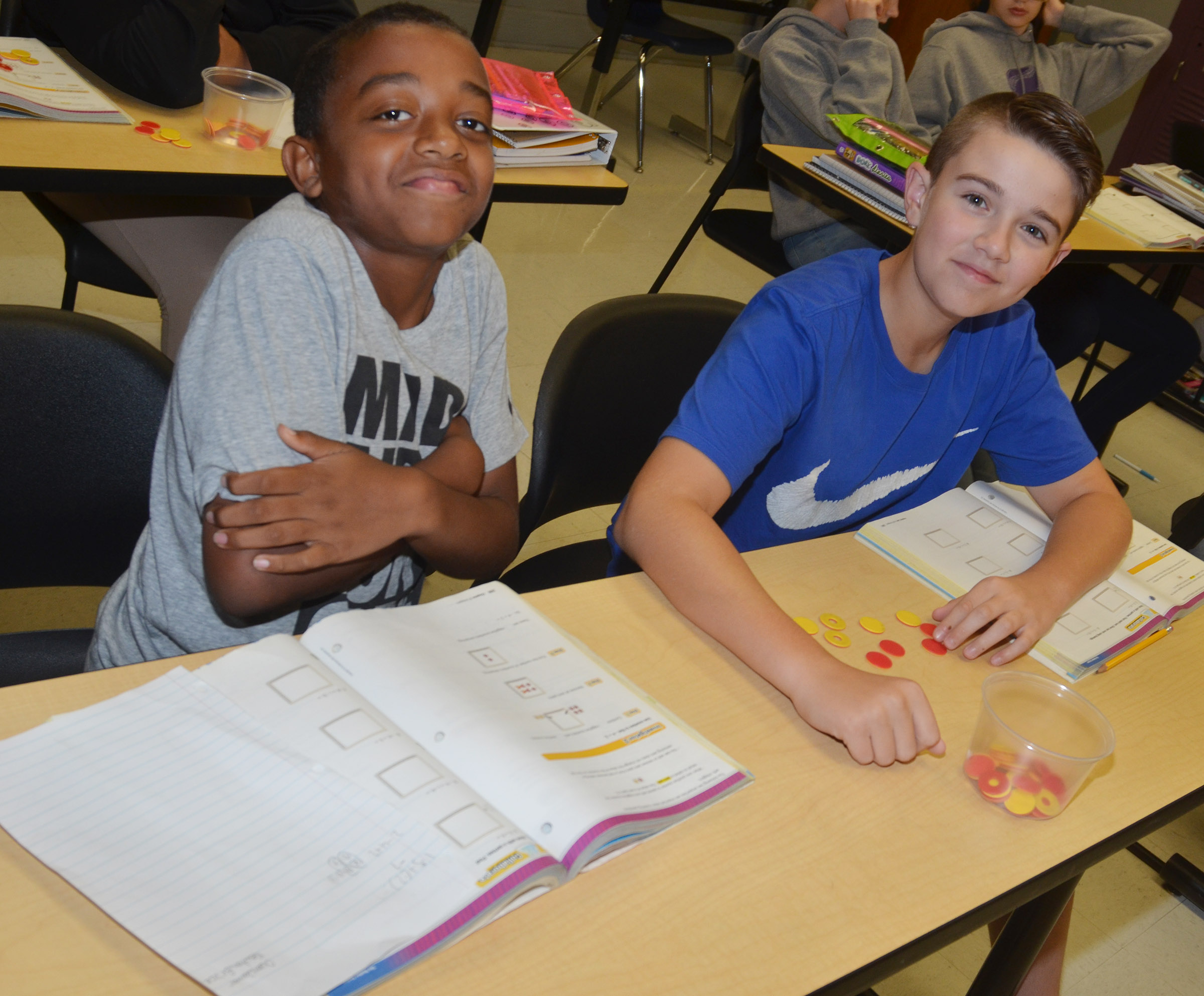 CMS seventh-graders Zamar Owens, at left, and Bryce Newton work a math problem with their counters.
