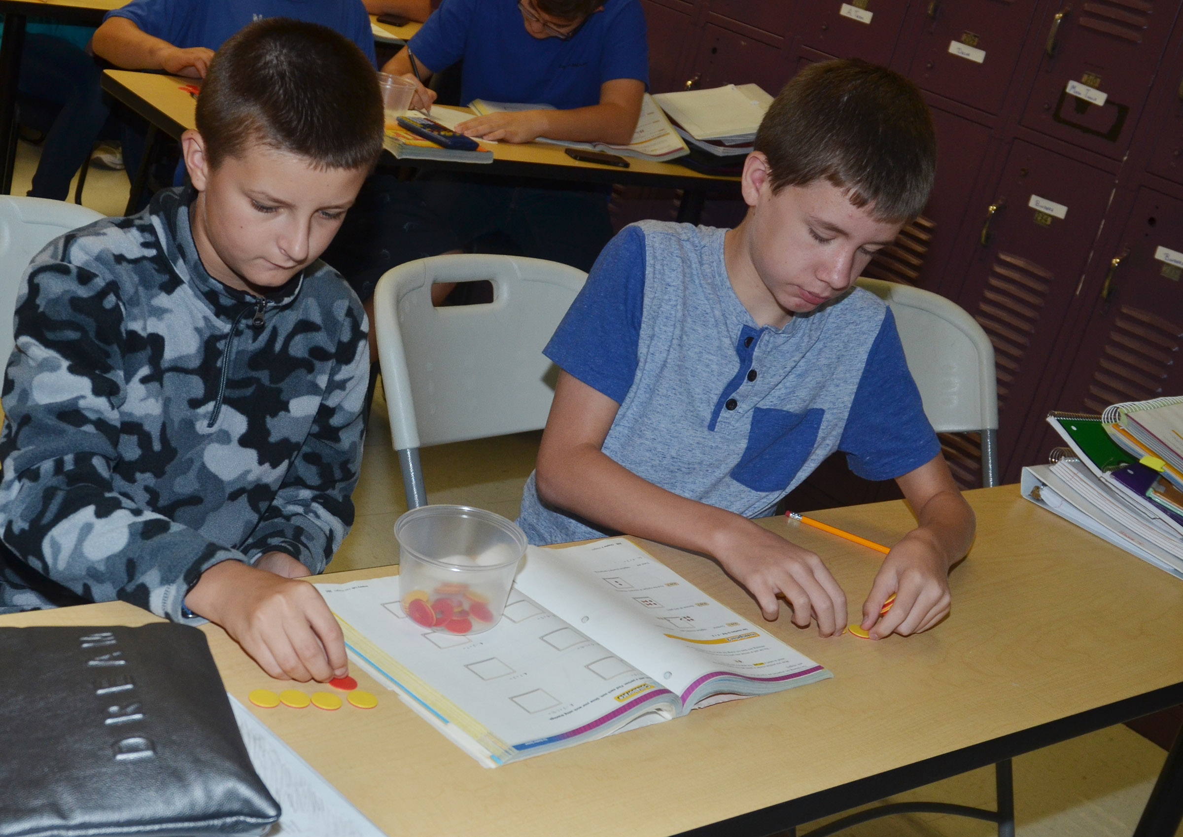 CMS seventh-graders Elijah Adams, at left, and Blake Tungate work a math problem with their counters.