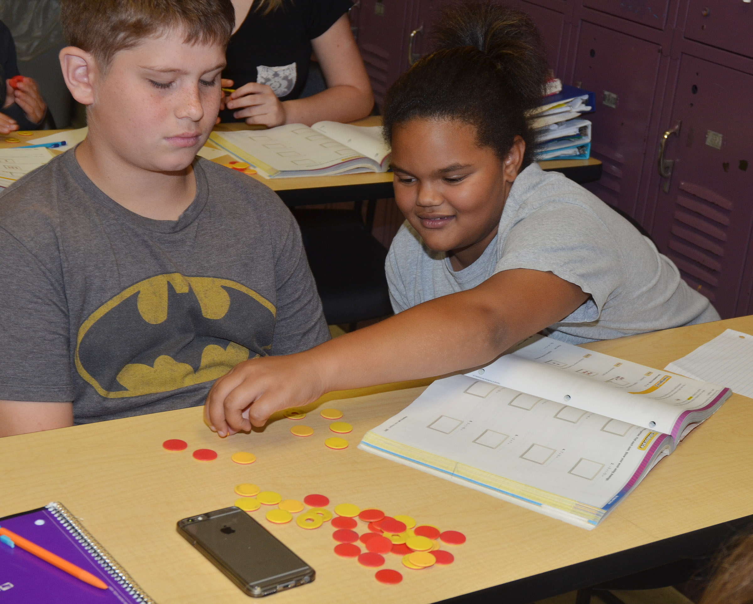 CMS seventh-graders Weston Mattingly, at left, and Alissa Lofton work a math problem with their counters.