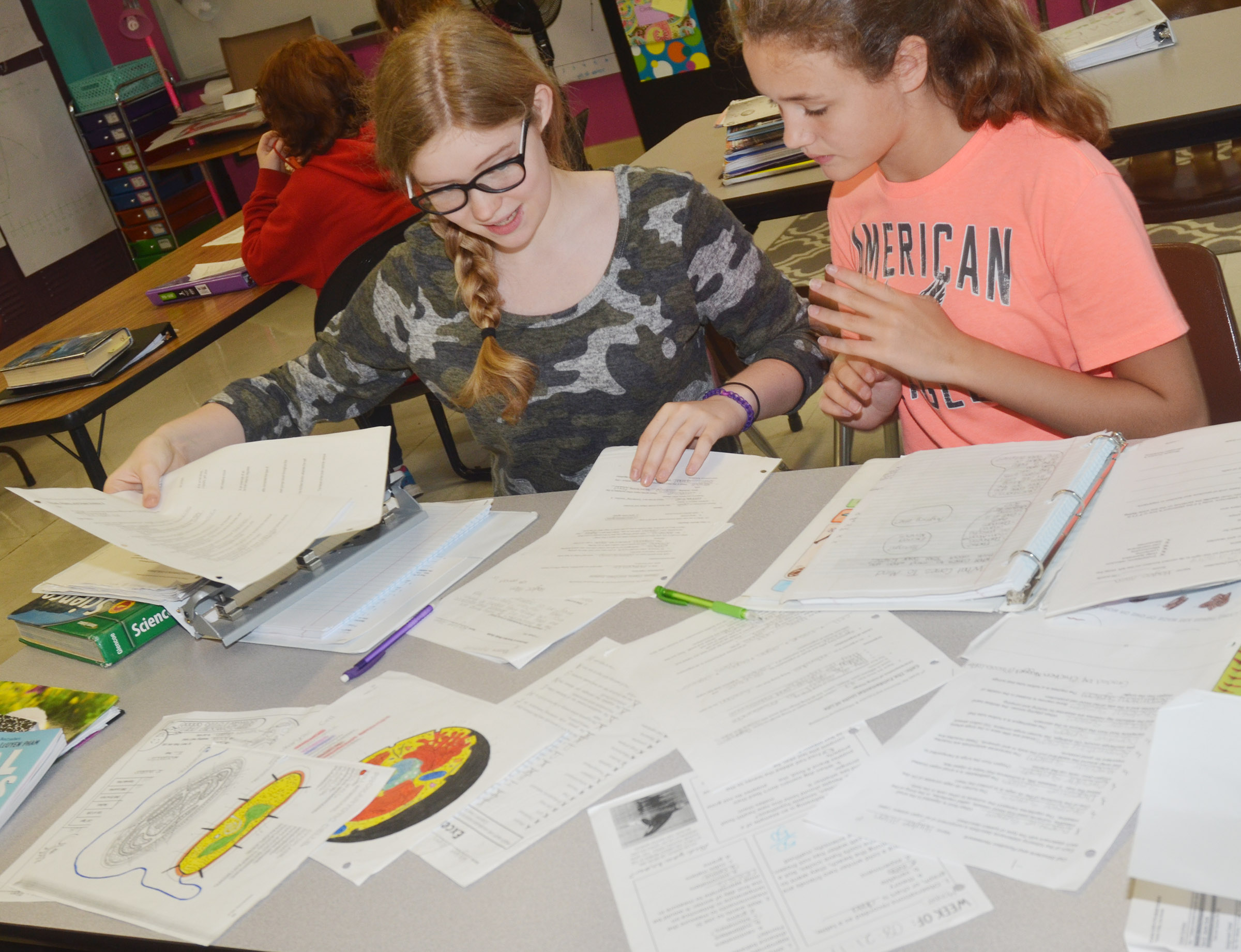 CMS seventh-graders Whitney Frashure, at left, and Haylee Allen review their notes together as they study.