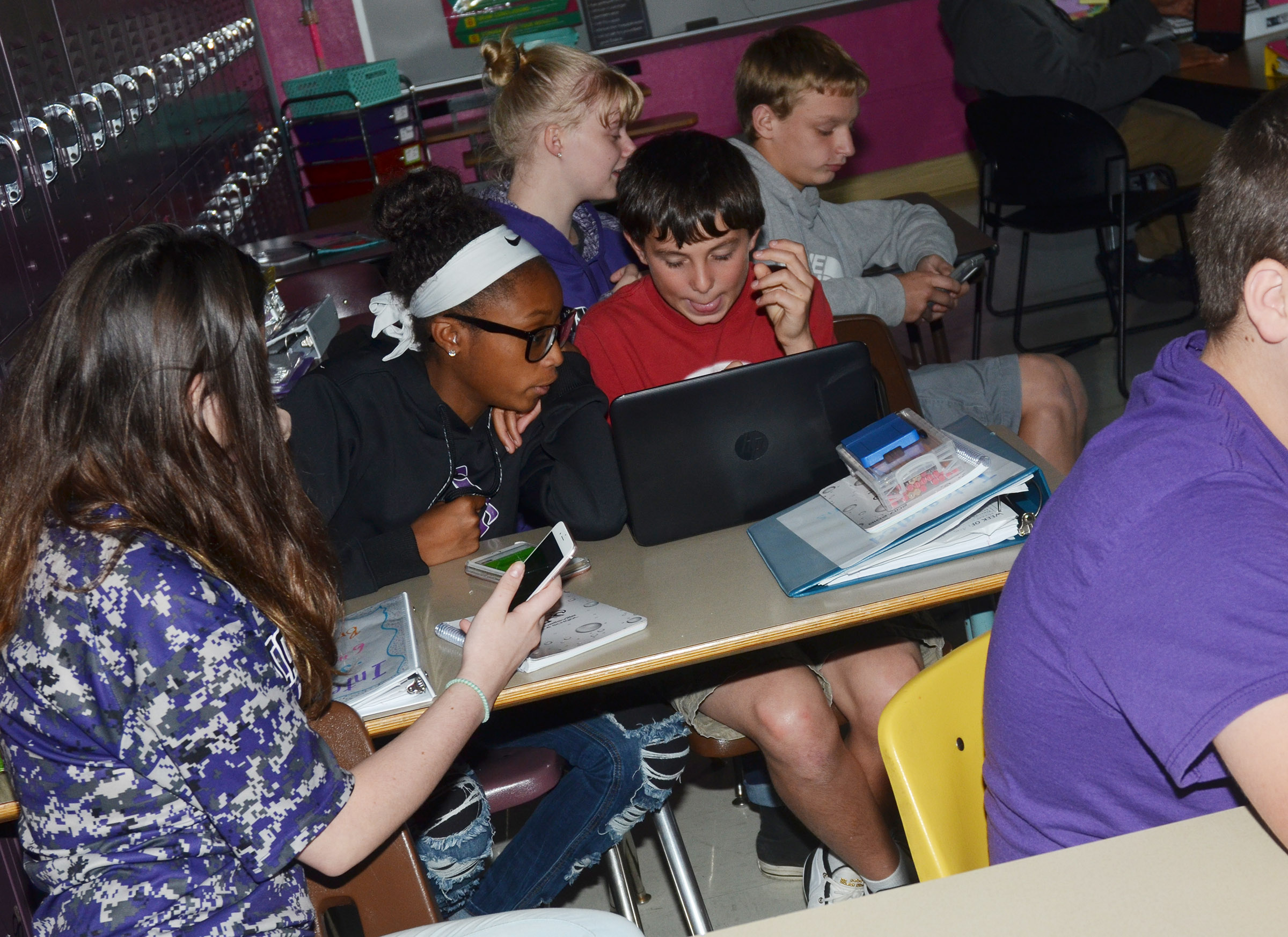 CMS eighth-graders Bri Gowdy, at left, and Dakota Harris compete with their classmates in a game of Kahoot!
