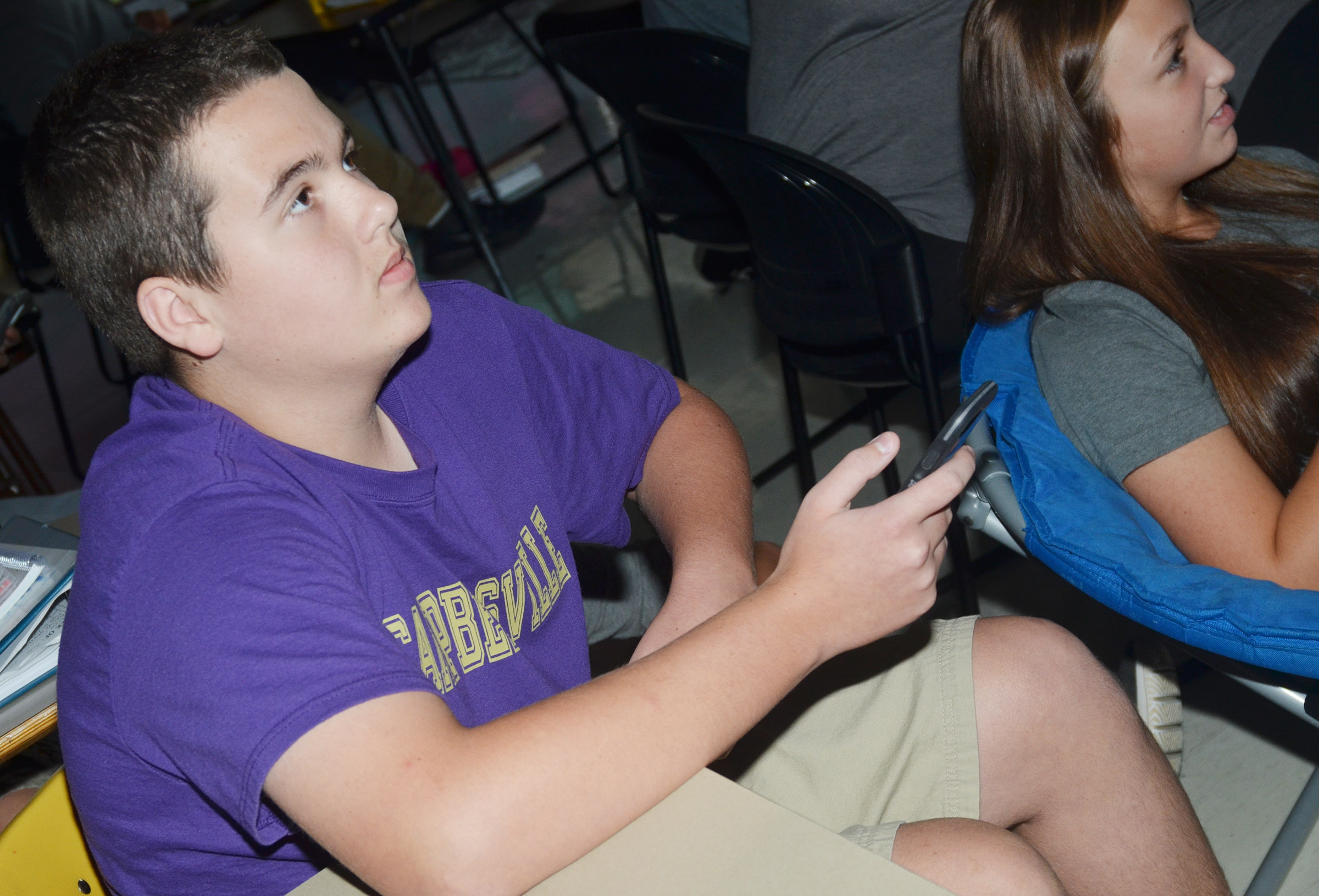 CMS eighth-grader Jack Sabo competes with Lainey Watson in a game of Kahoot!