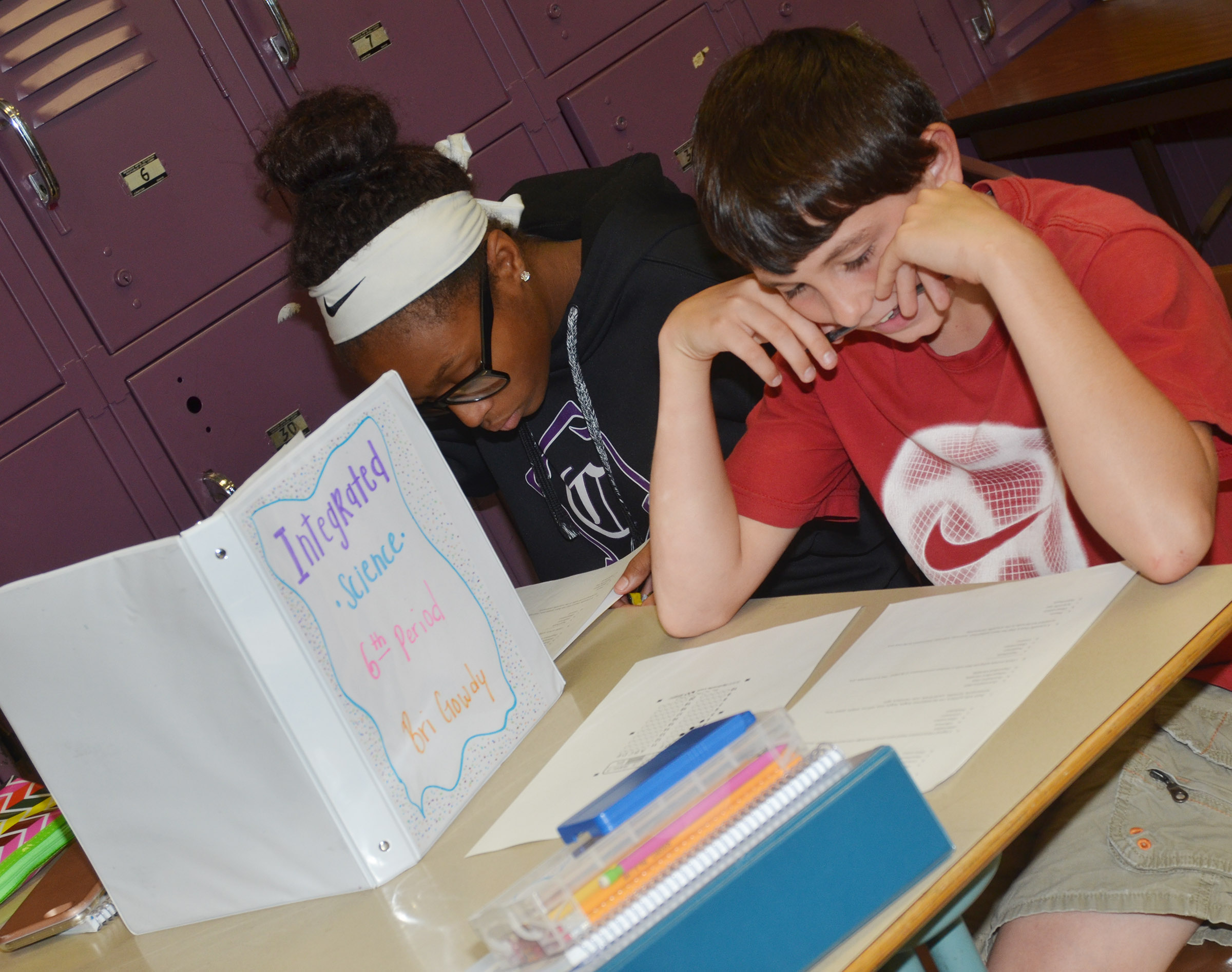 CMS eighth-graders Bri Gowdy, at left, and Dakota Harris answer the questions on their vocabulary quizzes.