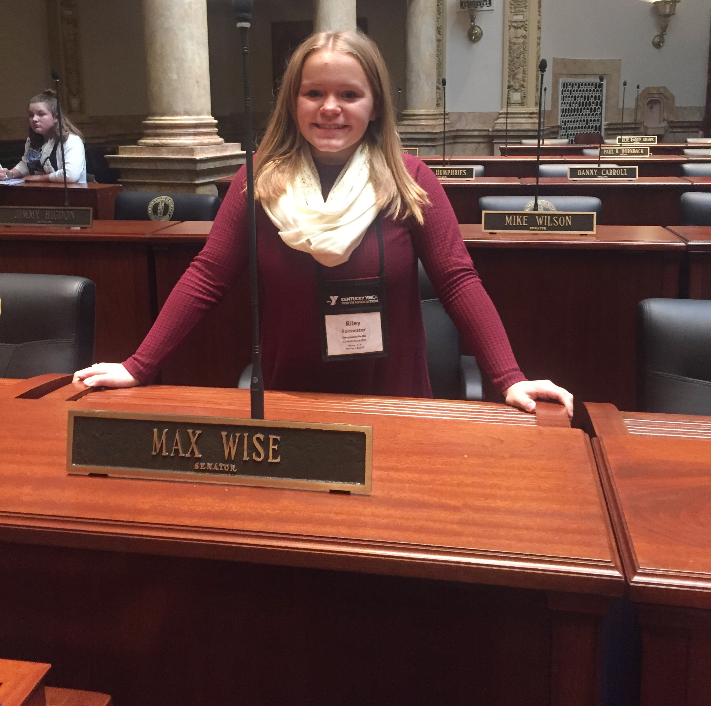 CMS seventh-grader Riley Rainwater sits on the Senate floor, at the desk belonging to State Sen. Max Wise, R-Campbellsville.