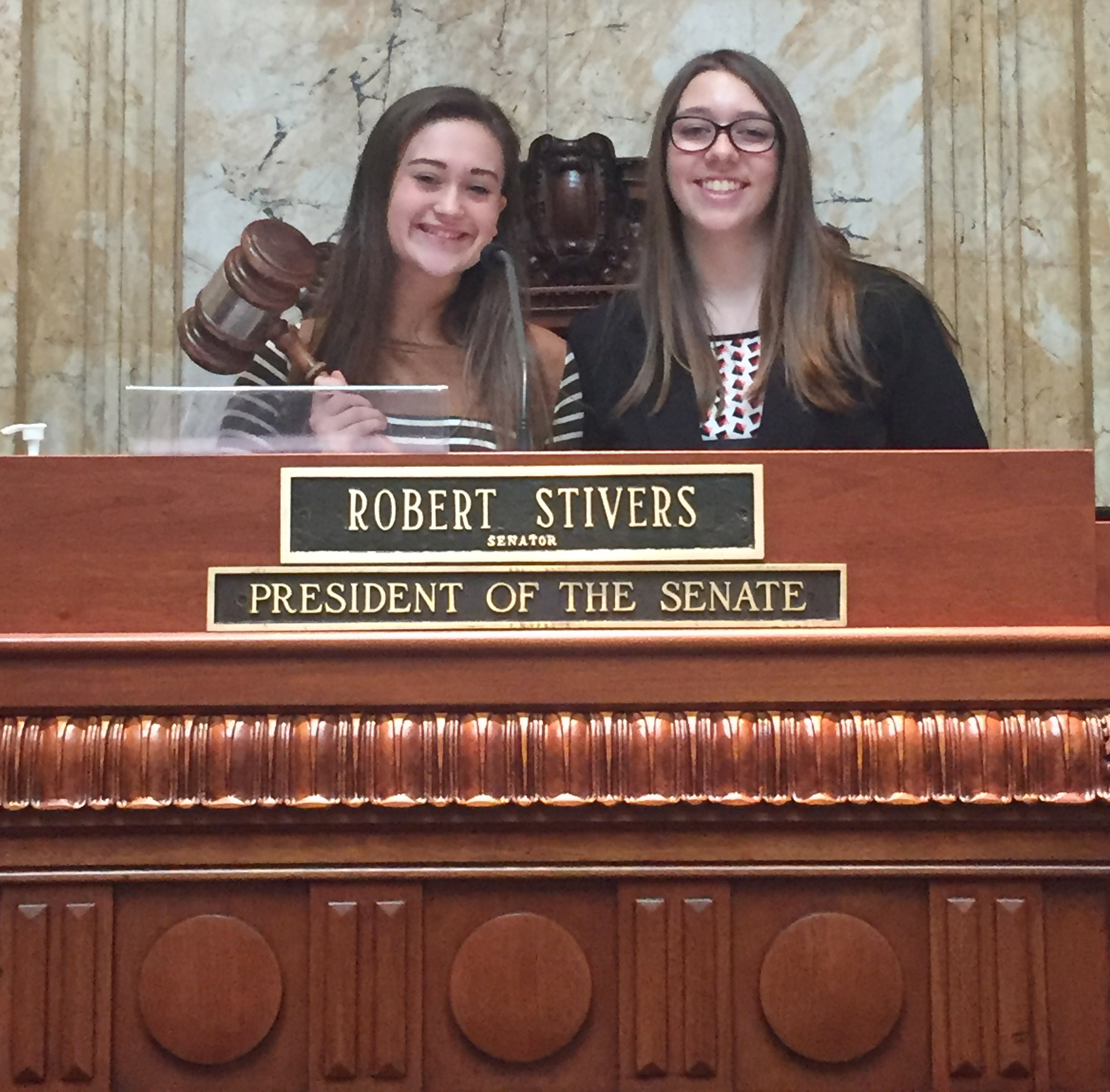 CHS freshman Bailey Thompson performs her duties as president of the Senate, with eighth-grader Abi Wiedewitsch, who was the Senate clerk.