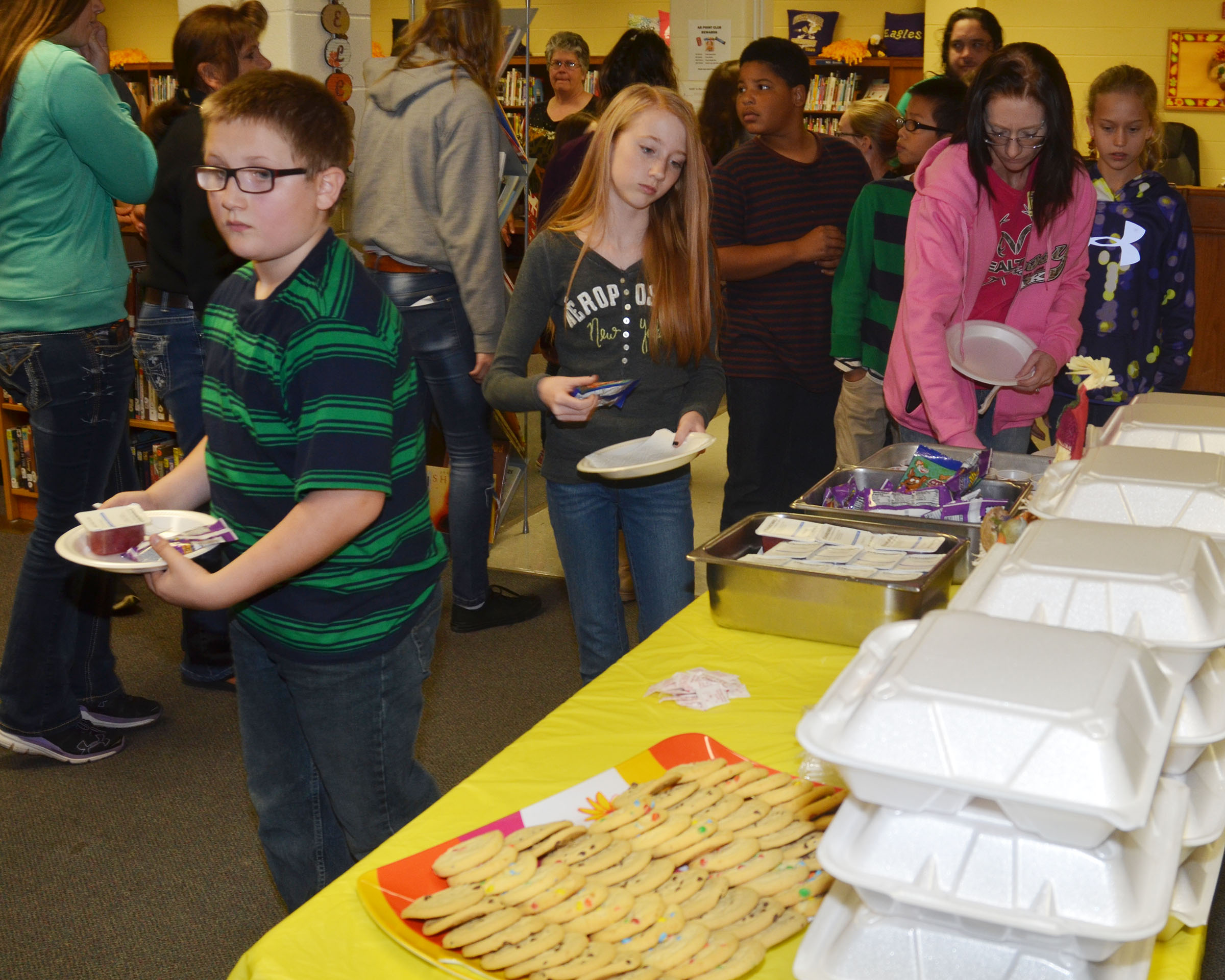 CMS student leaders are served a Thanksgiving lunch, with cookies for dessert.
