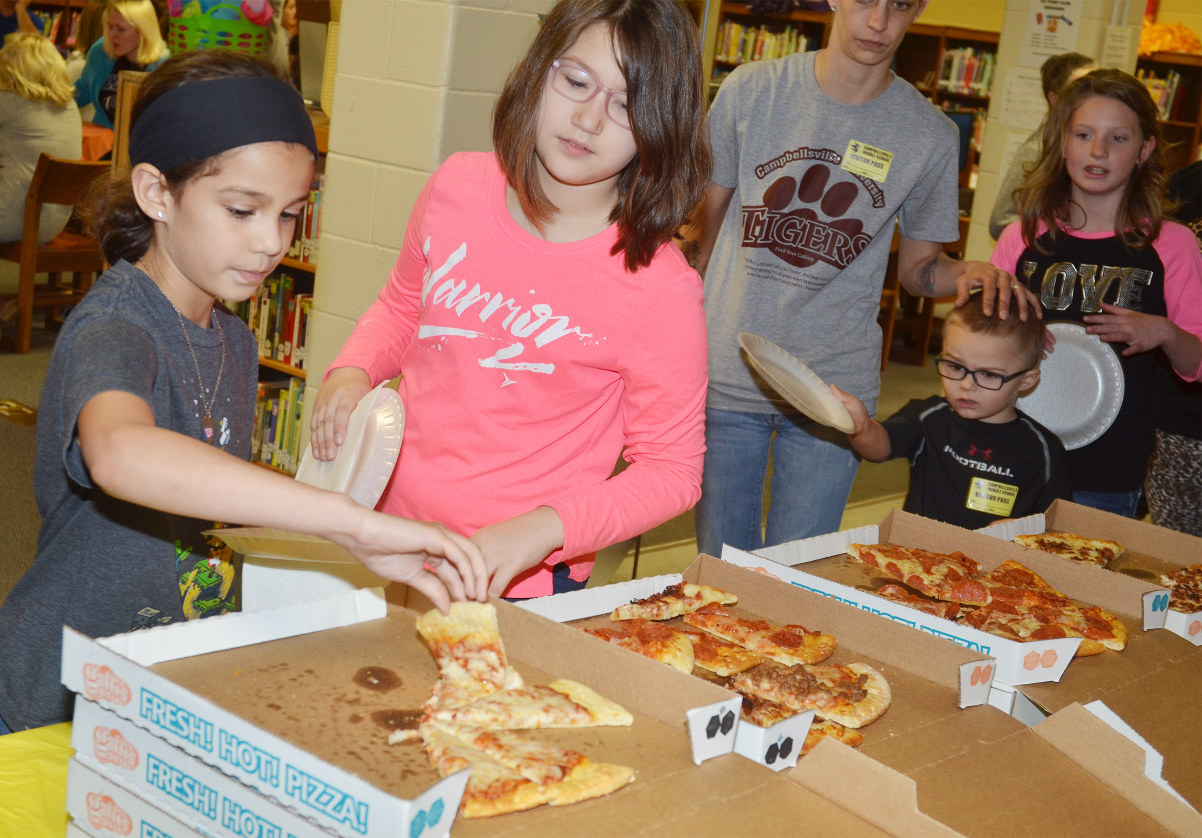 CMS fourth-graders Mackenzie Negron, at left, and Kylee Sowders are treated to a special lunch.