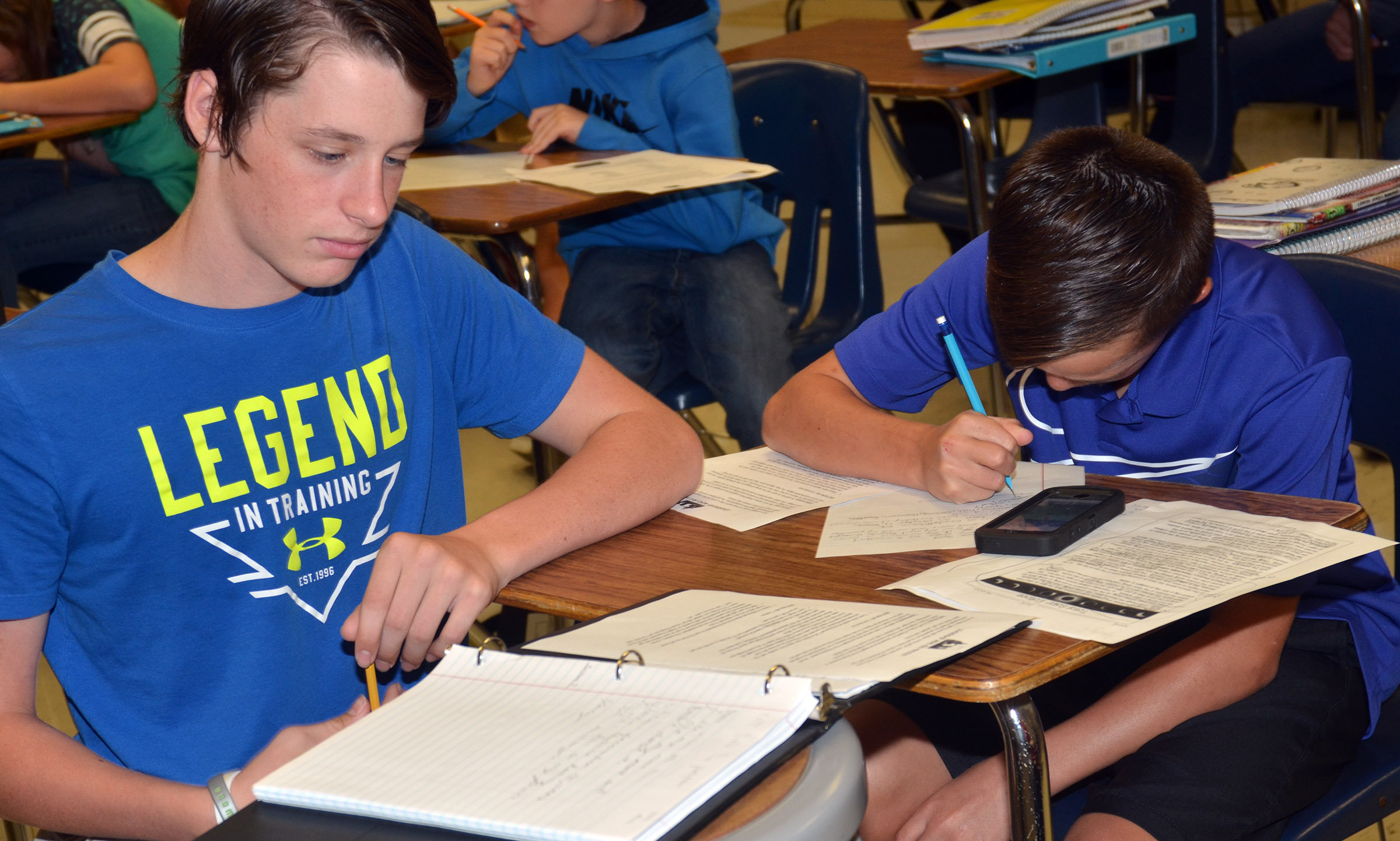 CMS seventh-graders Seth Hash, at left, and Chase Hord work on their autobiographical assignment.