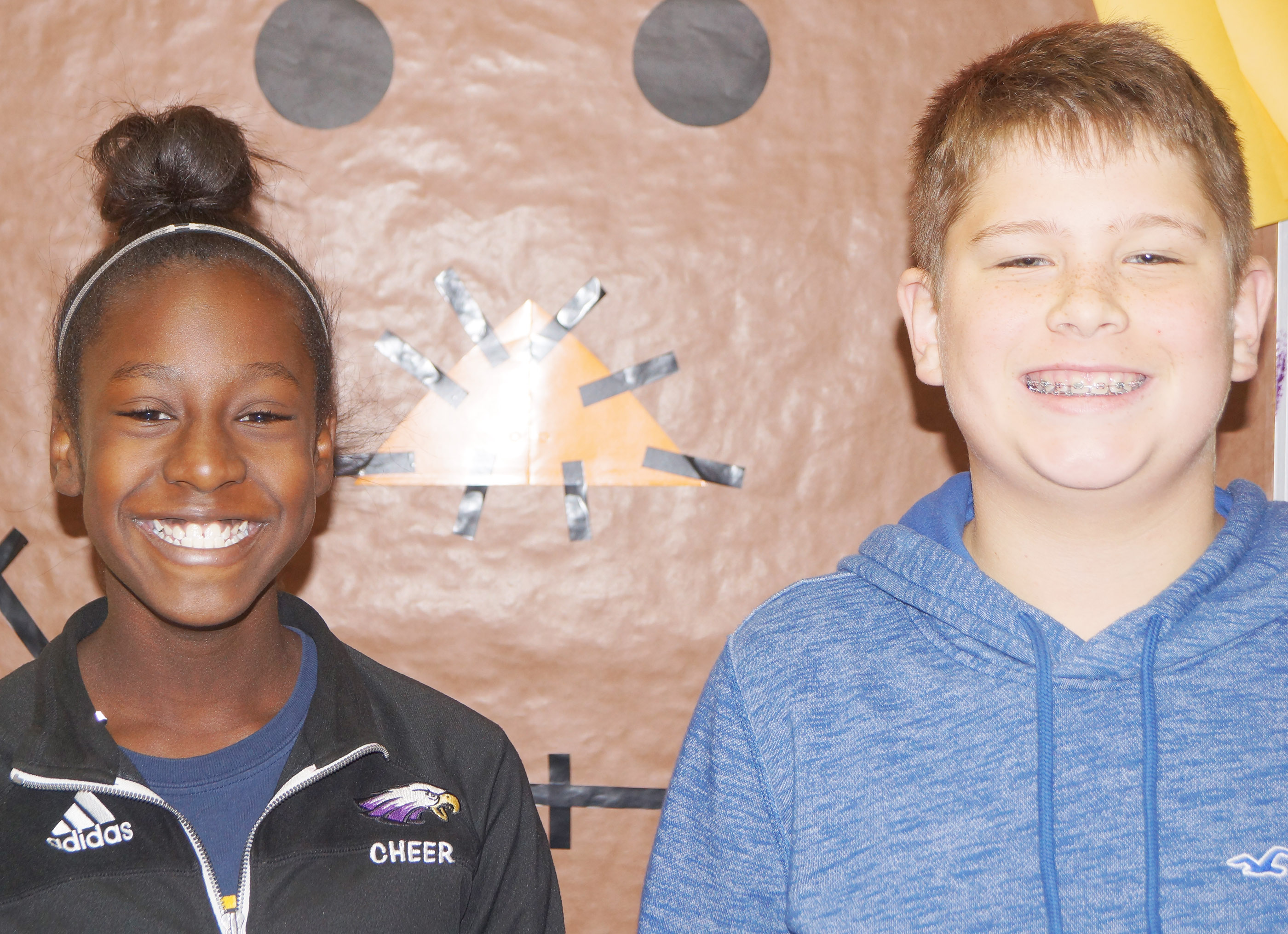 From left are eighth-grader Myricle Gholston and seventh-grader Weston Mattingly. Sixth-grader Aryanna Britton isn't pictured.