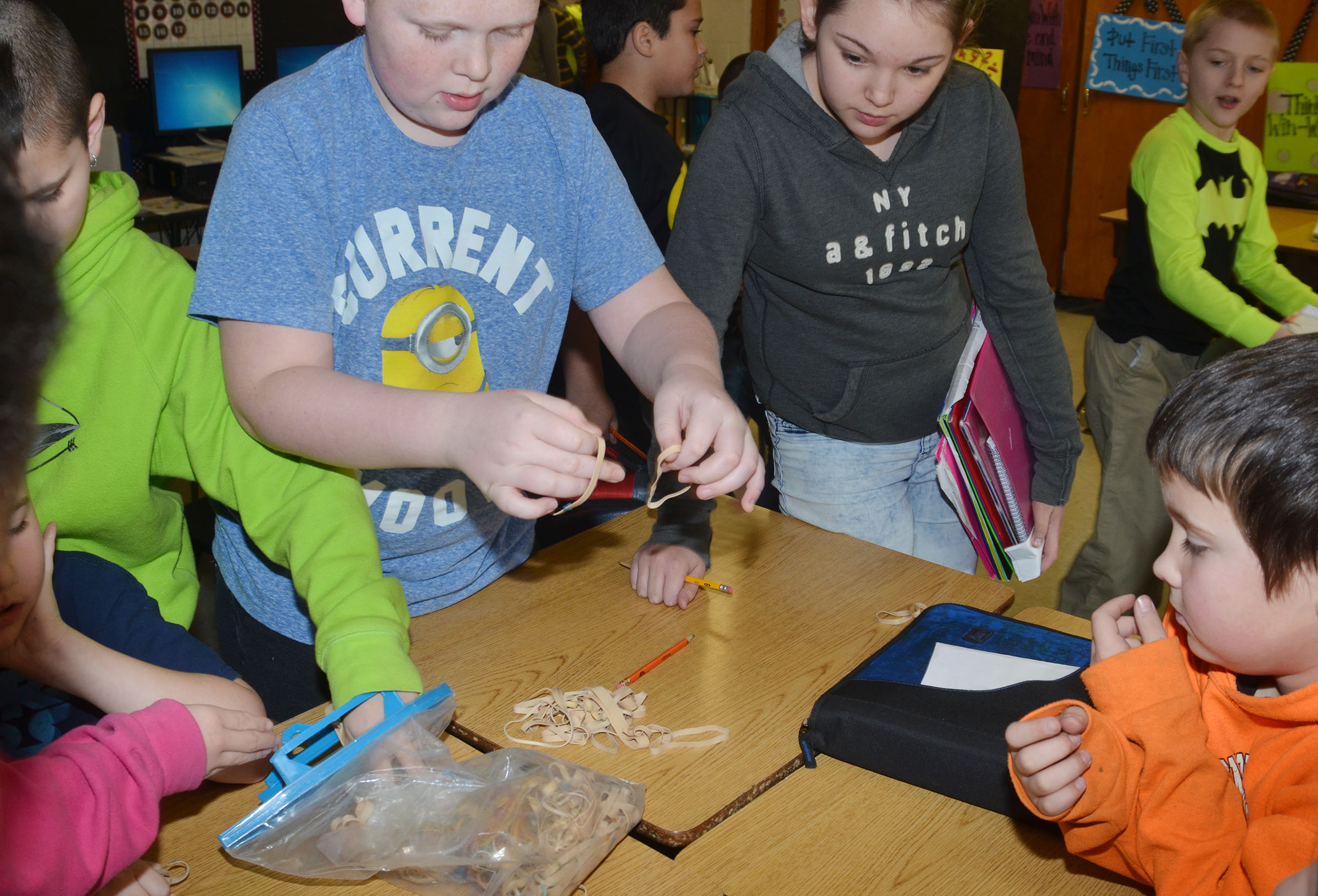 CMS fourth-grader Simon Wilkerson and his classmates count 100 rubber bands.
