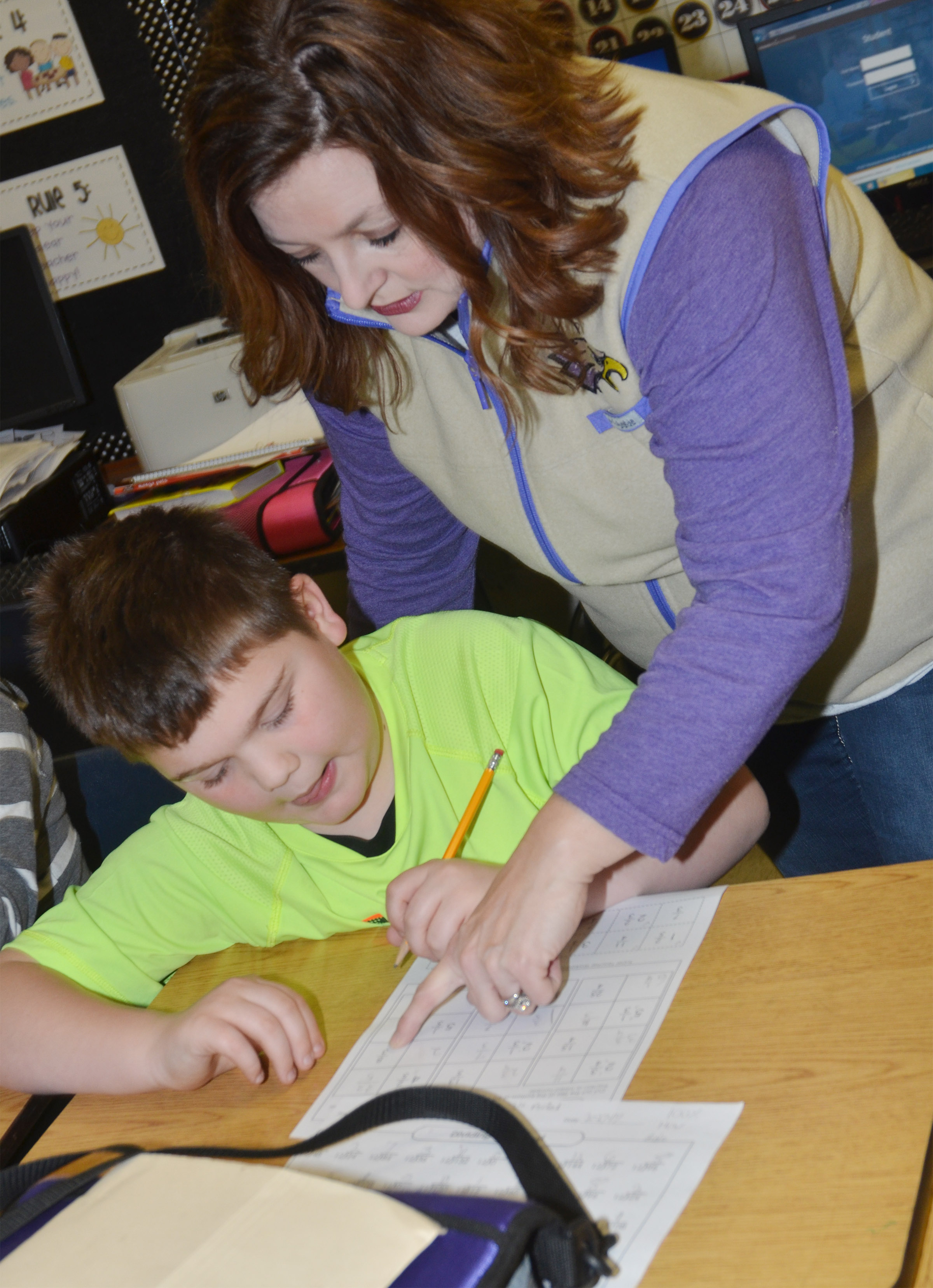 CMS fifth-grade teacher Garnetta Murrell helps Logan England convert a mixed number to a fraction.