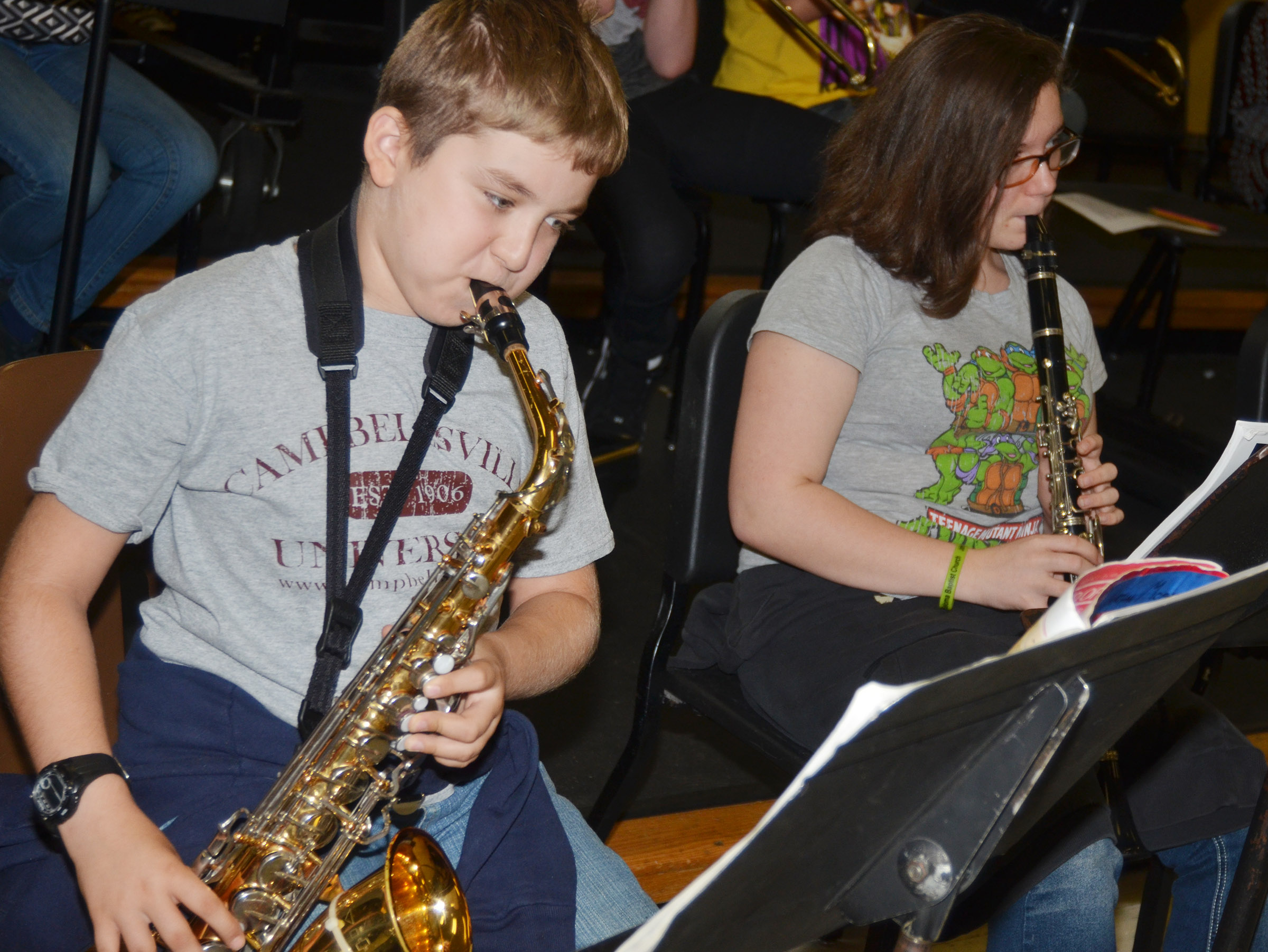 CMS sixth-grader Nathan McFarland, at left, plays saxophone while eighth-grader Serenity Tungate plays clarinet.