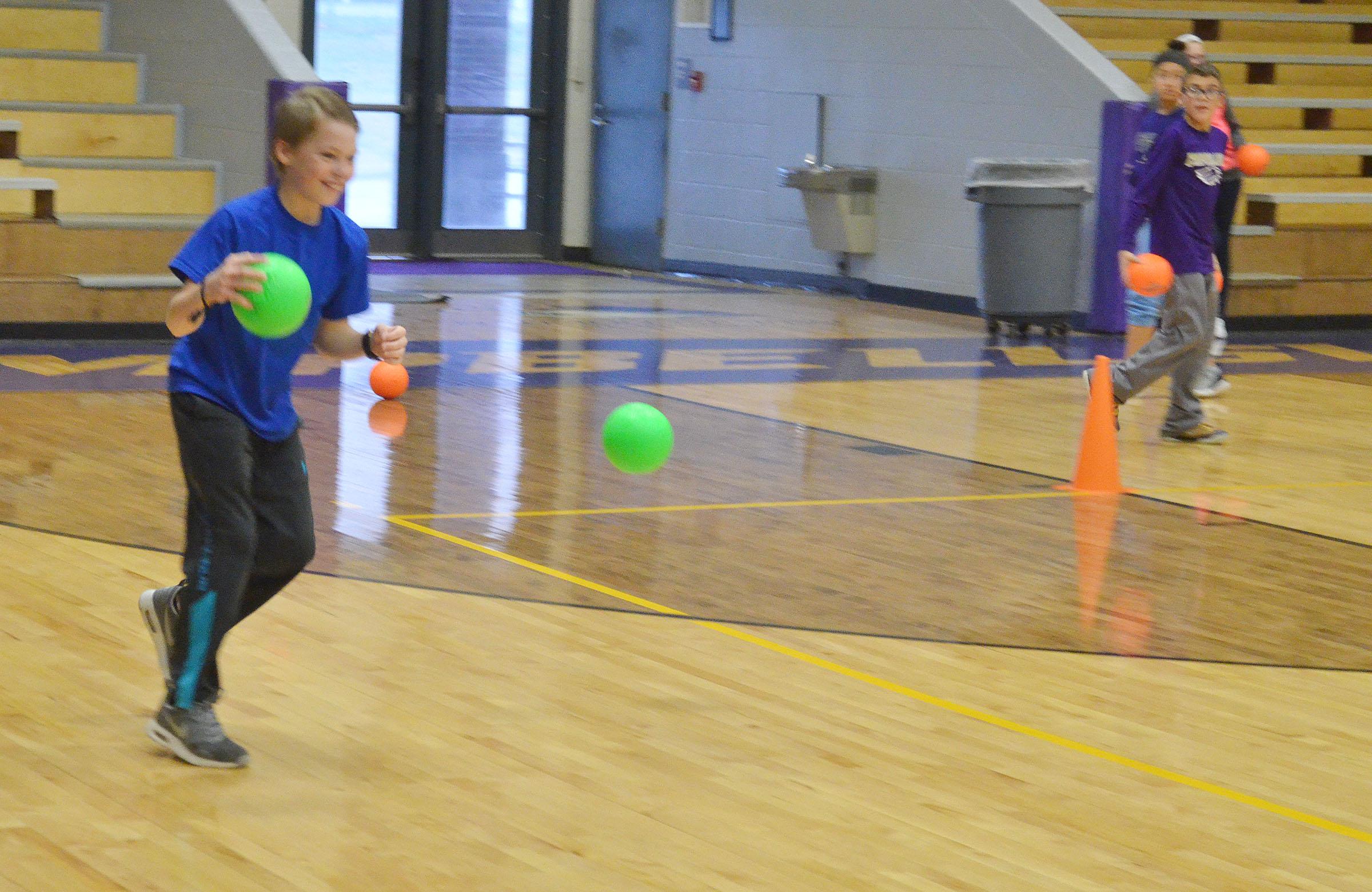 CMS seventh-grader Tuff Harper gets set to throw the dodgeball.