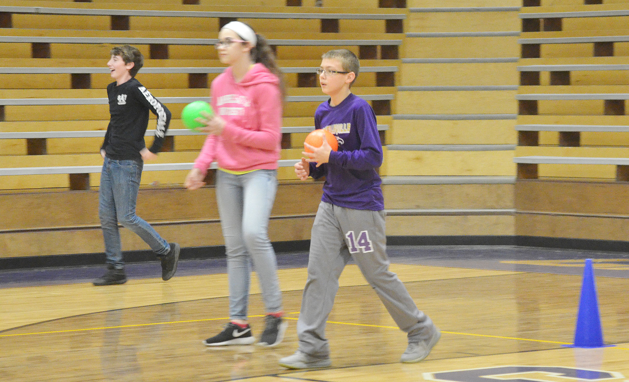 From left, CMS seventh-grader Waylon Franklin, sixth-grader Mary Russell and seventh-grader Jarred Mays defend their team.