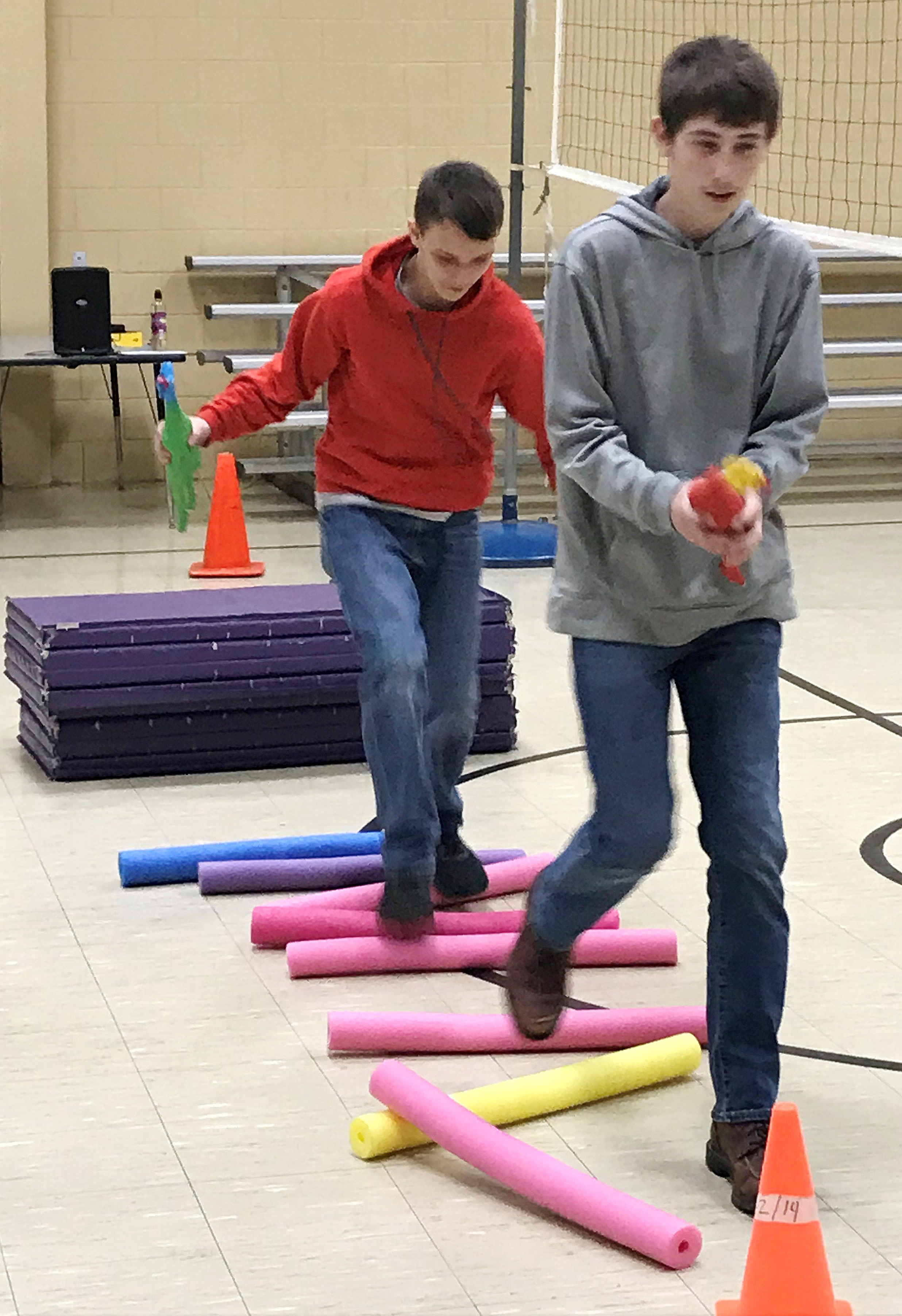 CMS eighth-graders Devin Roberts, at left, and Waylon Franklin complete the obstacle course.