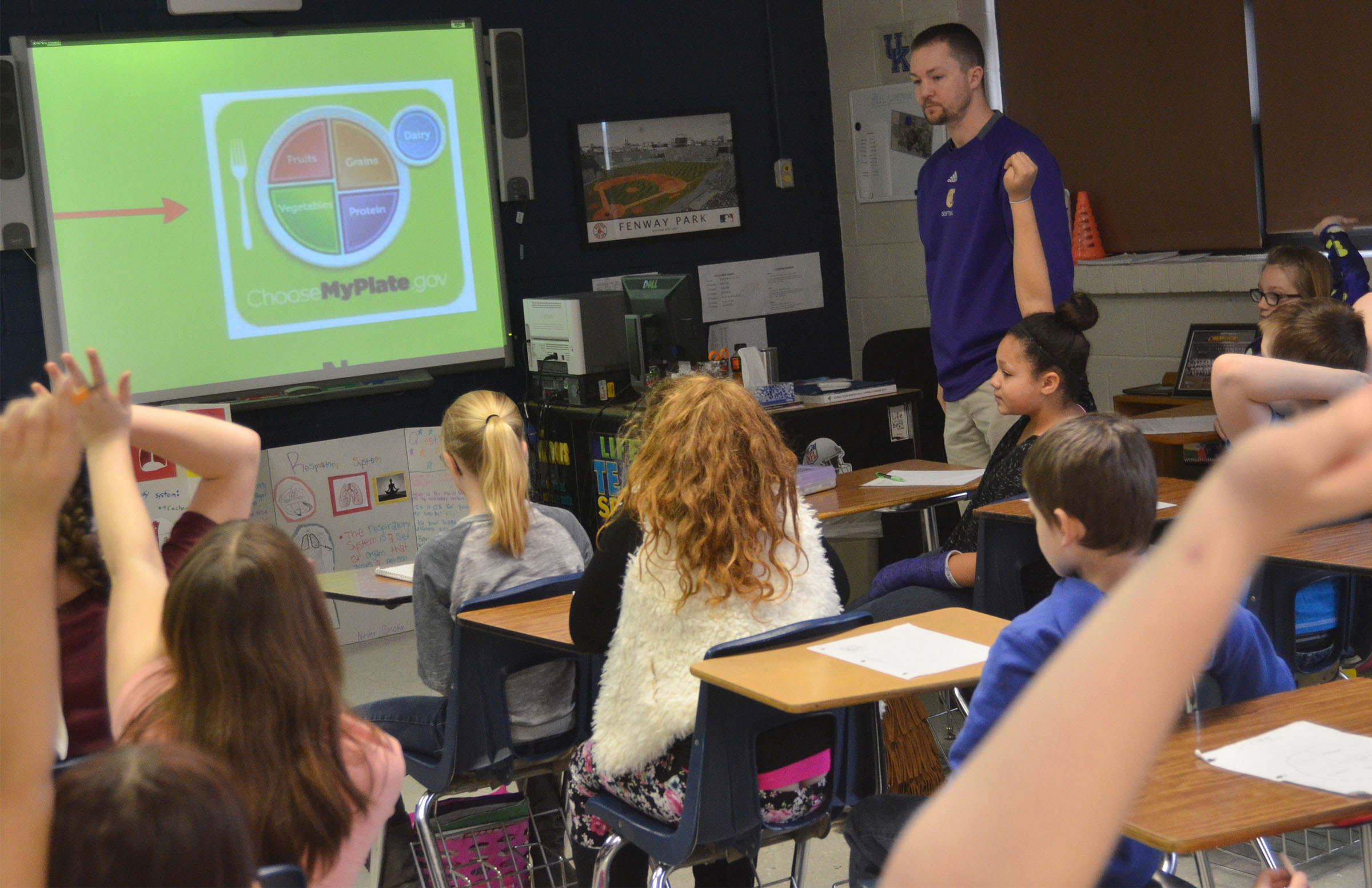 CMS physical education teacher Weston Jones talks to fourth-, fifth- and sixth-graders about the importance of a healthy and balanced diet.