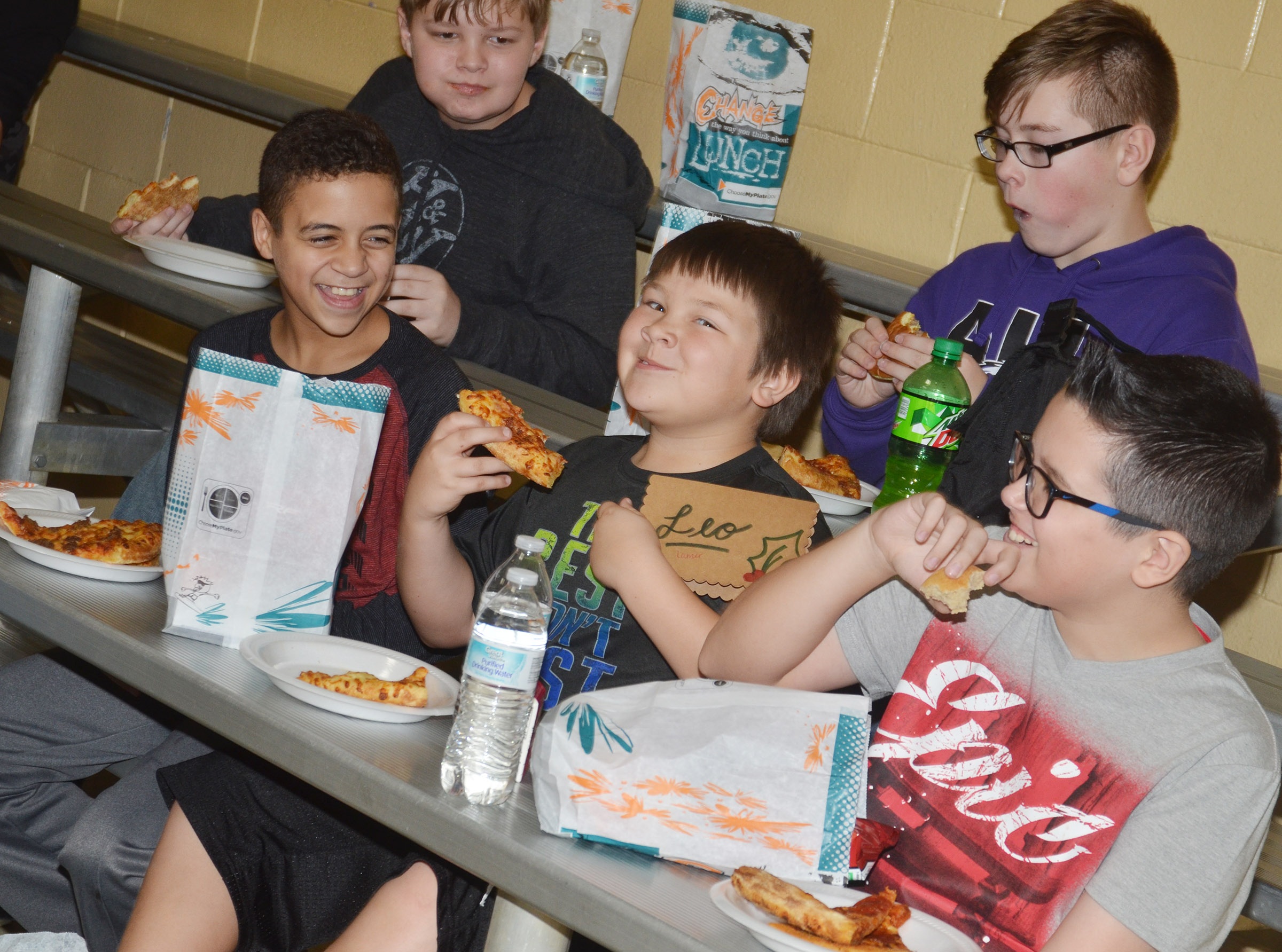 CMS sixth-graders enjoy their pizza. From left, front, are Tucker Cartwright, Leo Lamer and Chase Lawless. In back are Hunter Falls and Jovi Bowen.