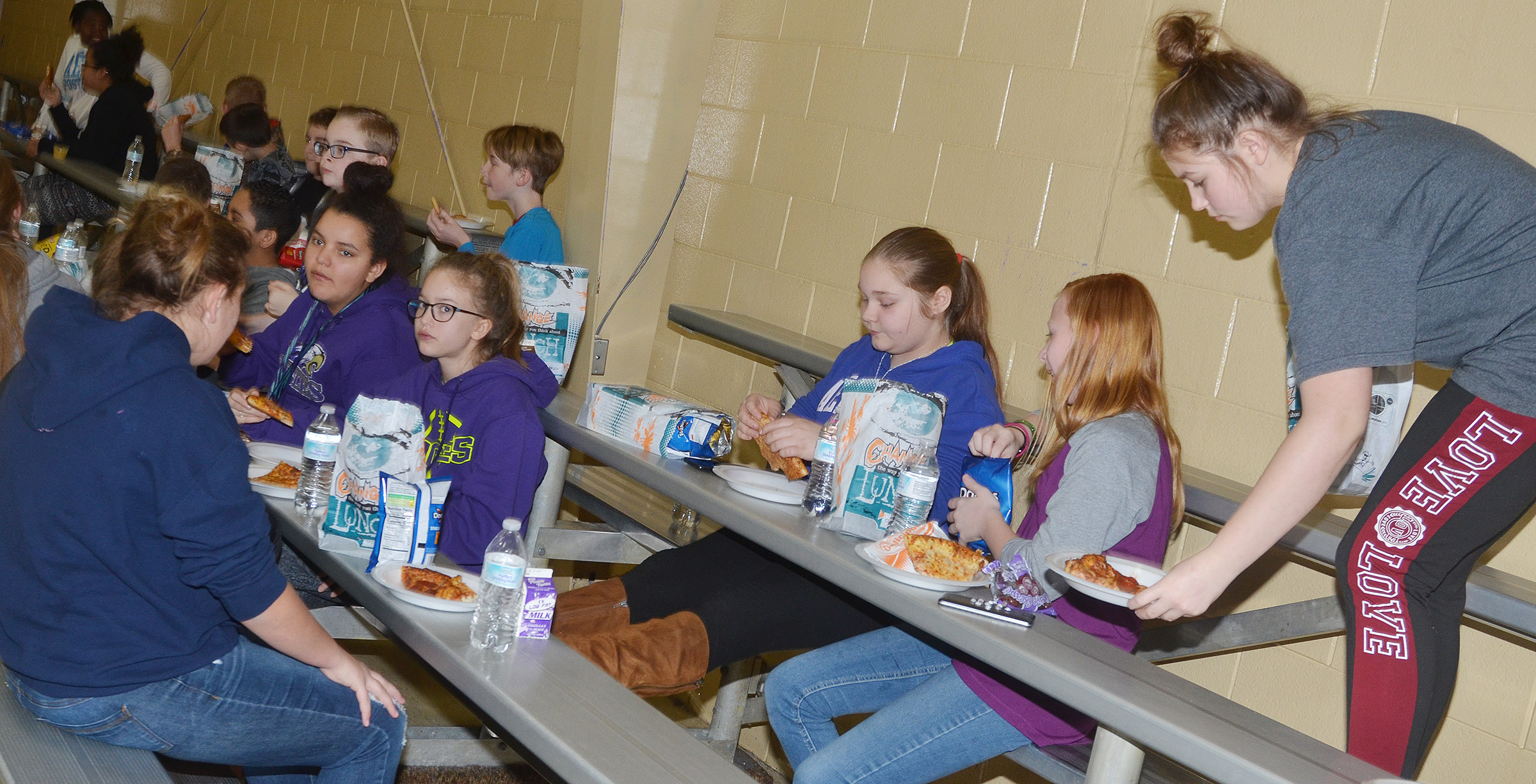CMS sixth-graders enjoy their pizza.