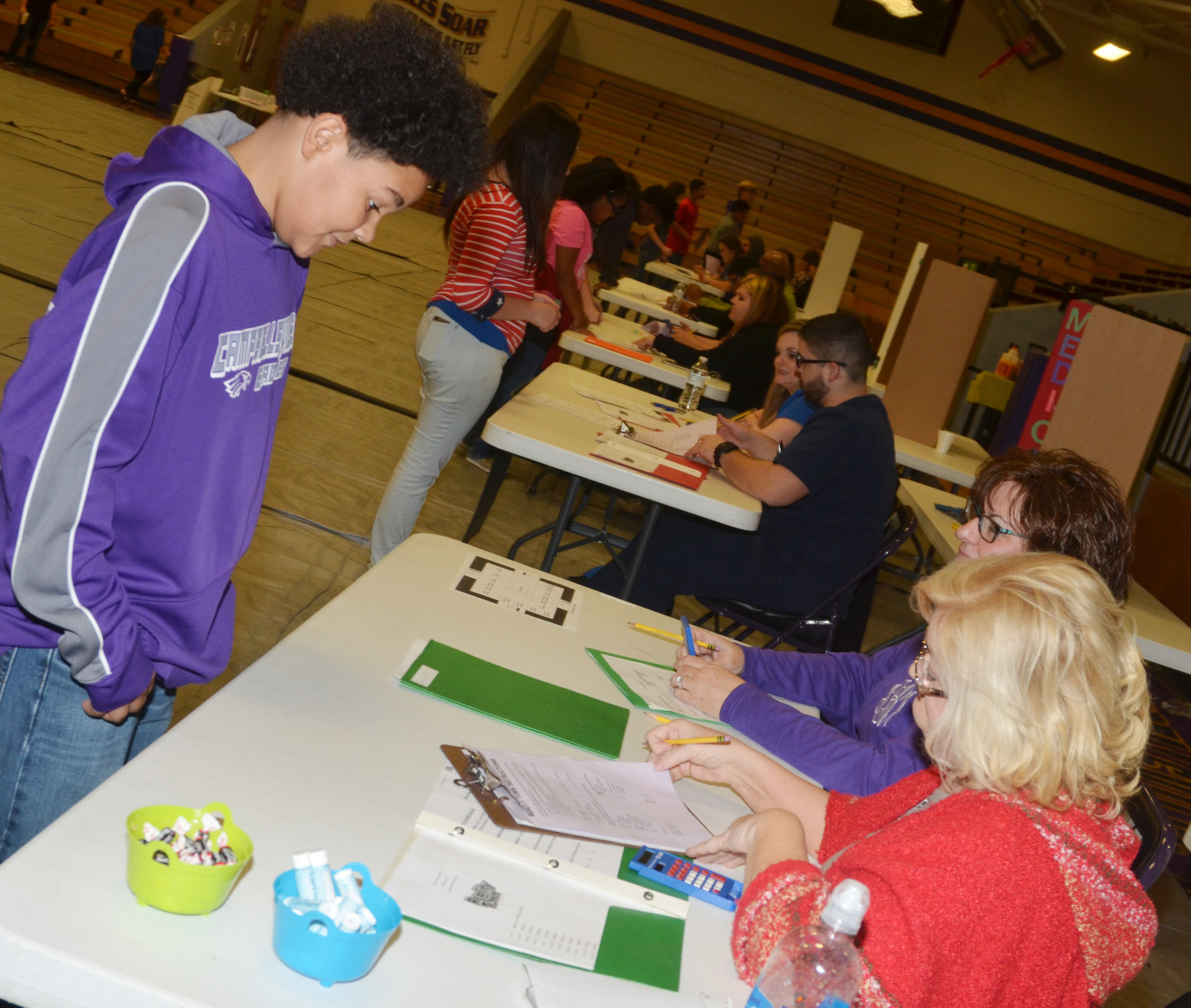 CMS eighth-grader Alex Lofton considers a purchase.
