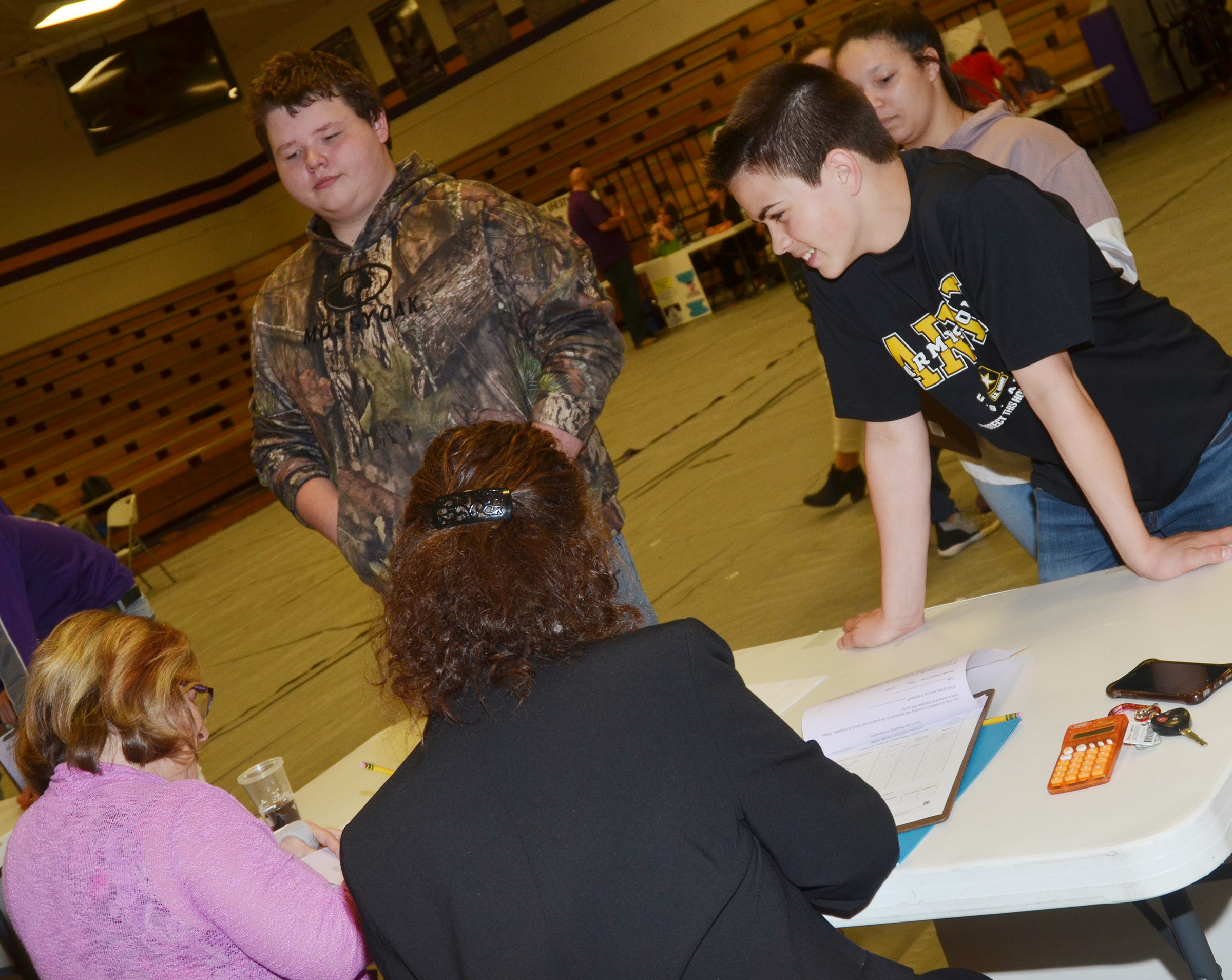 CMS eighth-graders, from left, Carsen Riley and Clark Kidwell consider a purchase.