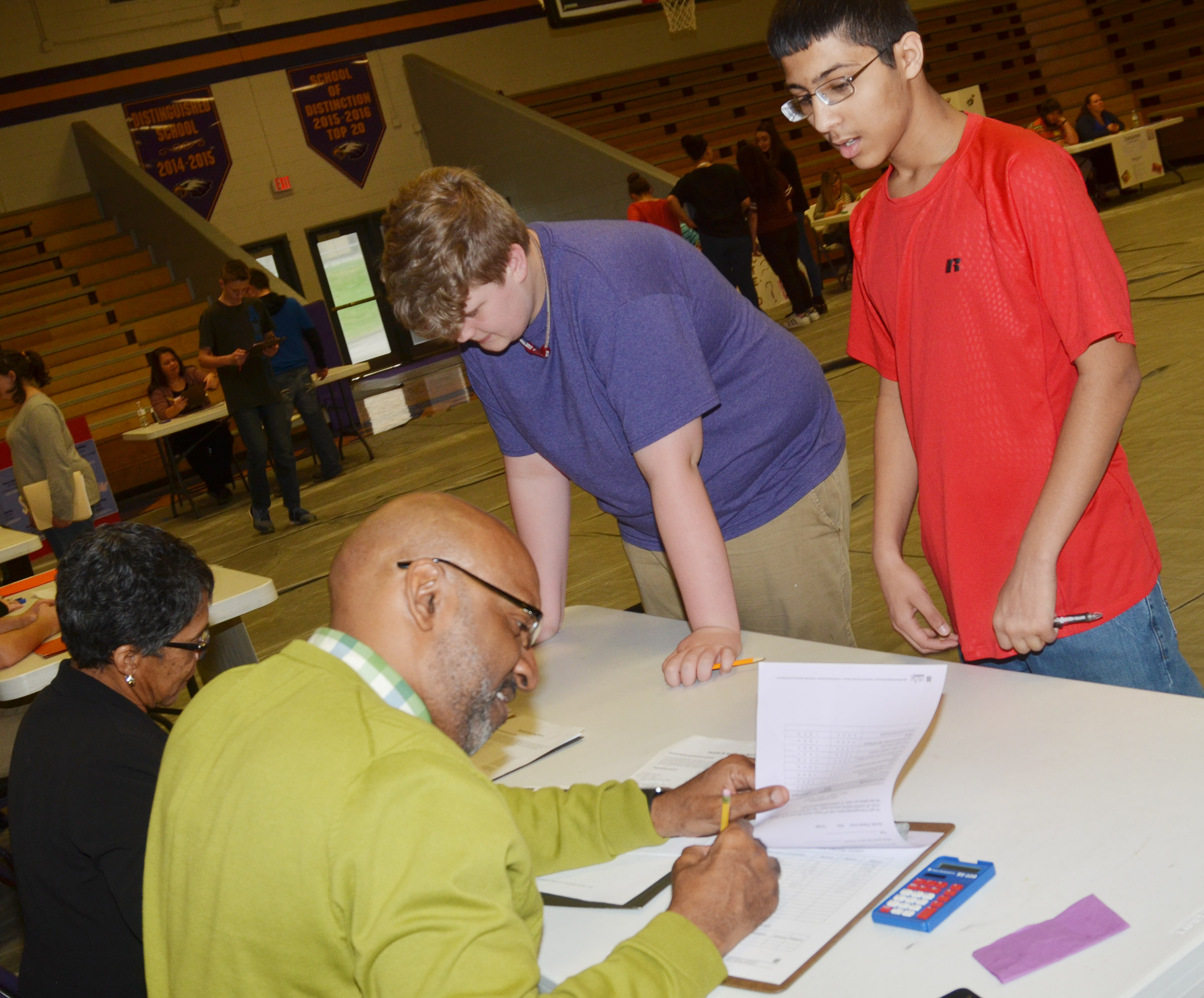 CMS eighth-graders Noah Mardis, at left, and Raj Patel visit the health booth.
