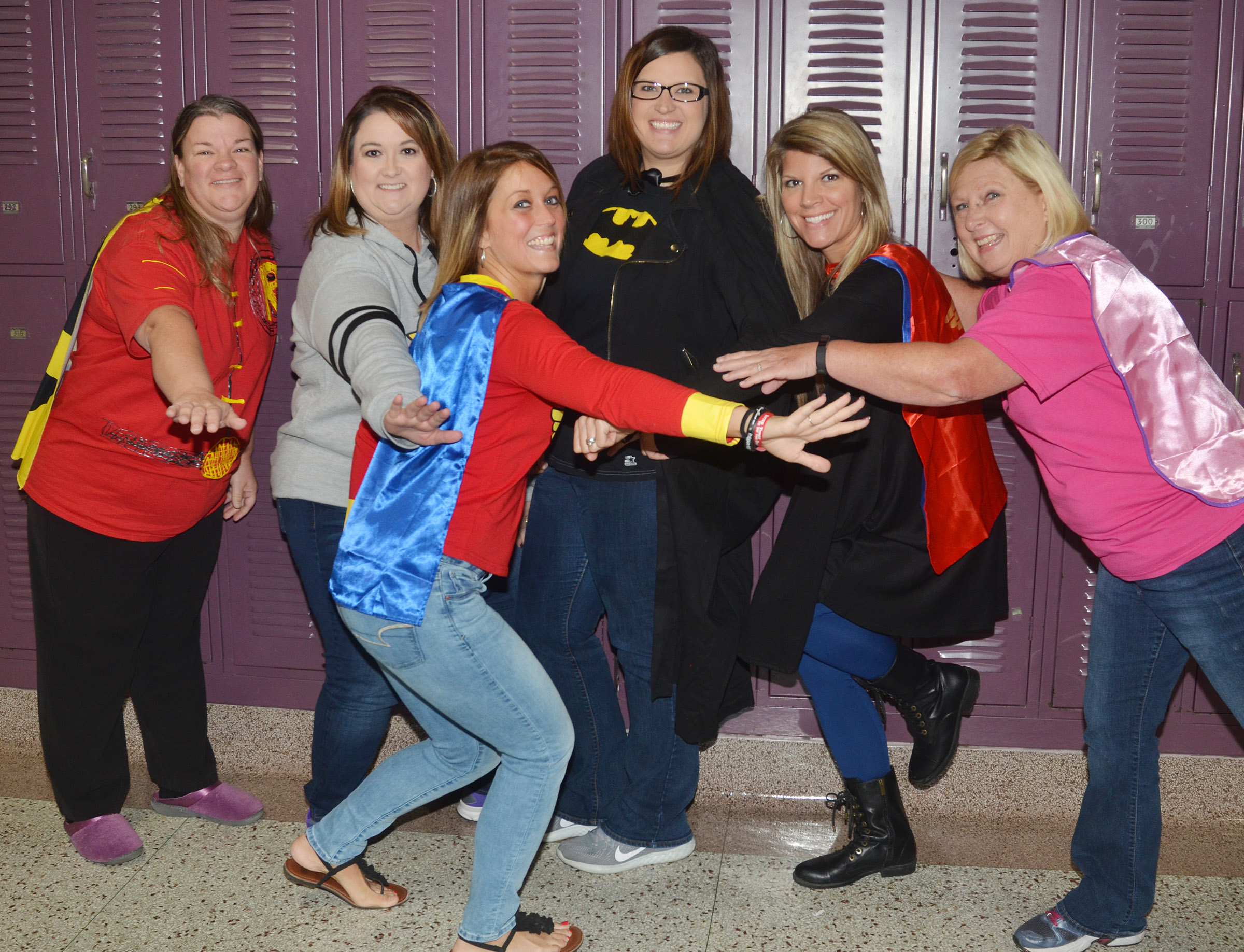 CMS teachers and administrators, from left, Robin Johnson, Amy Knifley, Natalia Warren, Robbilyn Speer, Andrea Gribbins and Jan Speer dress as superheroes for Real Heroes Don't Do Drugs Day.