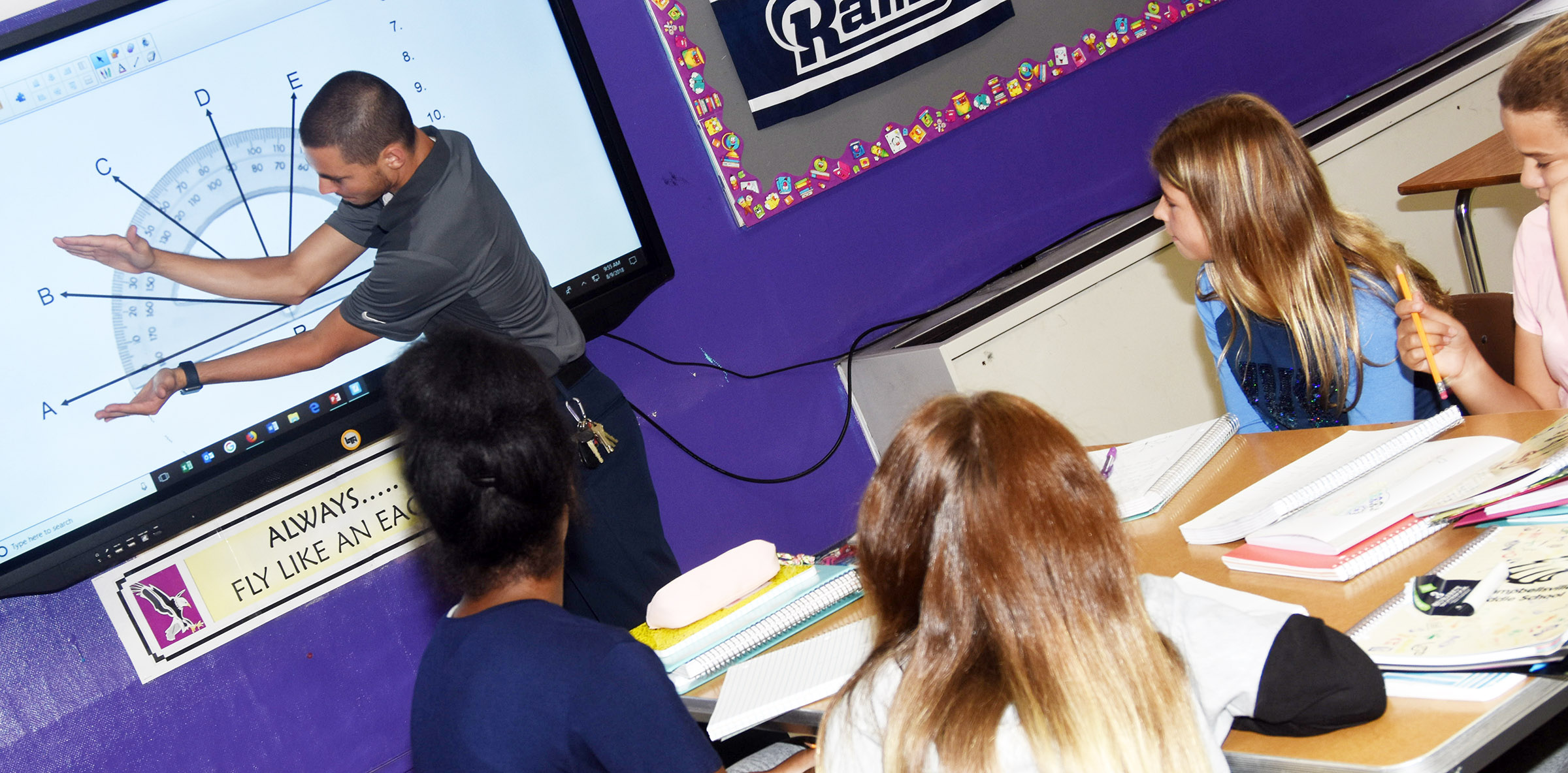 CMS seventh-grade teacher Bradley Harris talks to his students about angles.