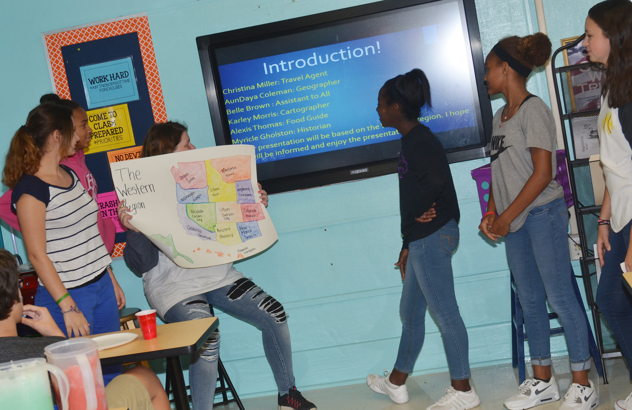 CMS eighth-graders, from left, Christina Miller, AunDaya Coleman, Belle Brown, Myricle Gholston, Alexis Thomas and Karley Morris present about the western region.