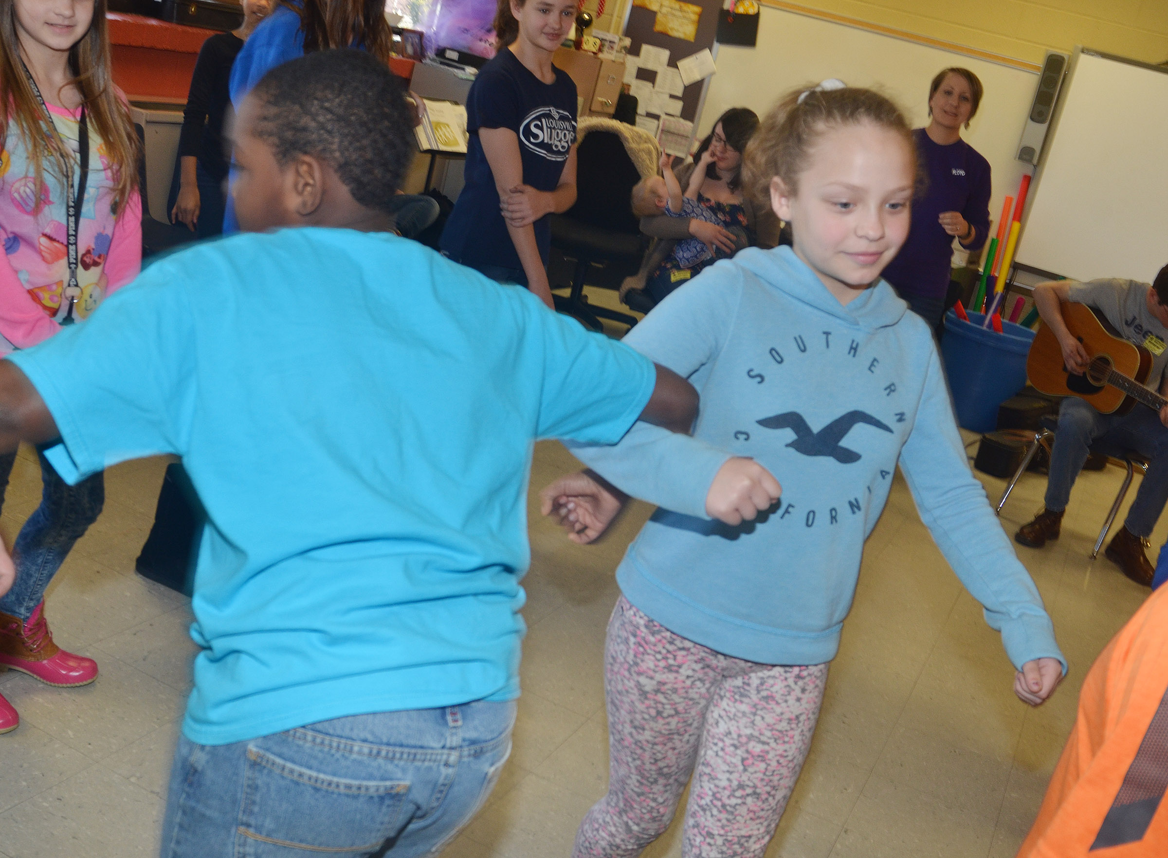 CMS fourth-graders Deason Smith, at left, and Deanna Reardon dance.