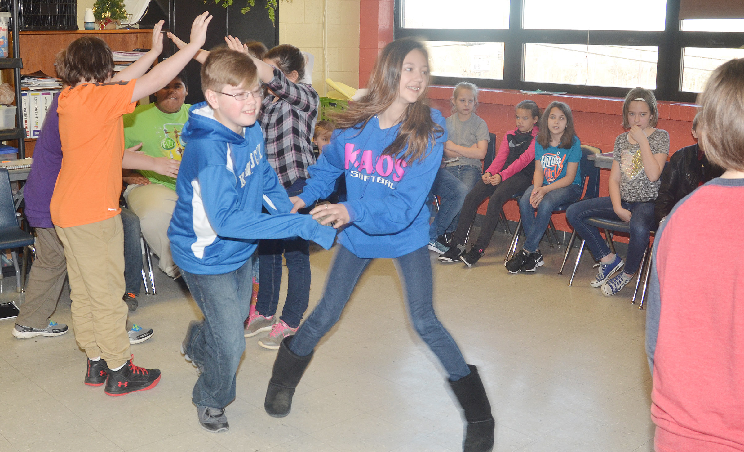 CMS fifth-grader Jovi Bowen dances with sixth-grader Bri Hayes.