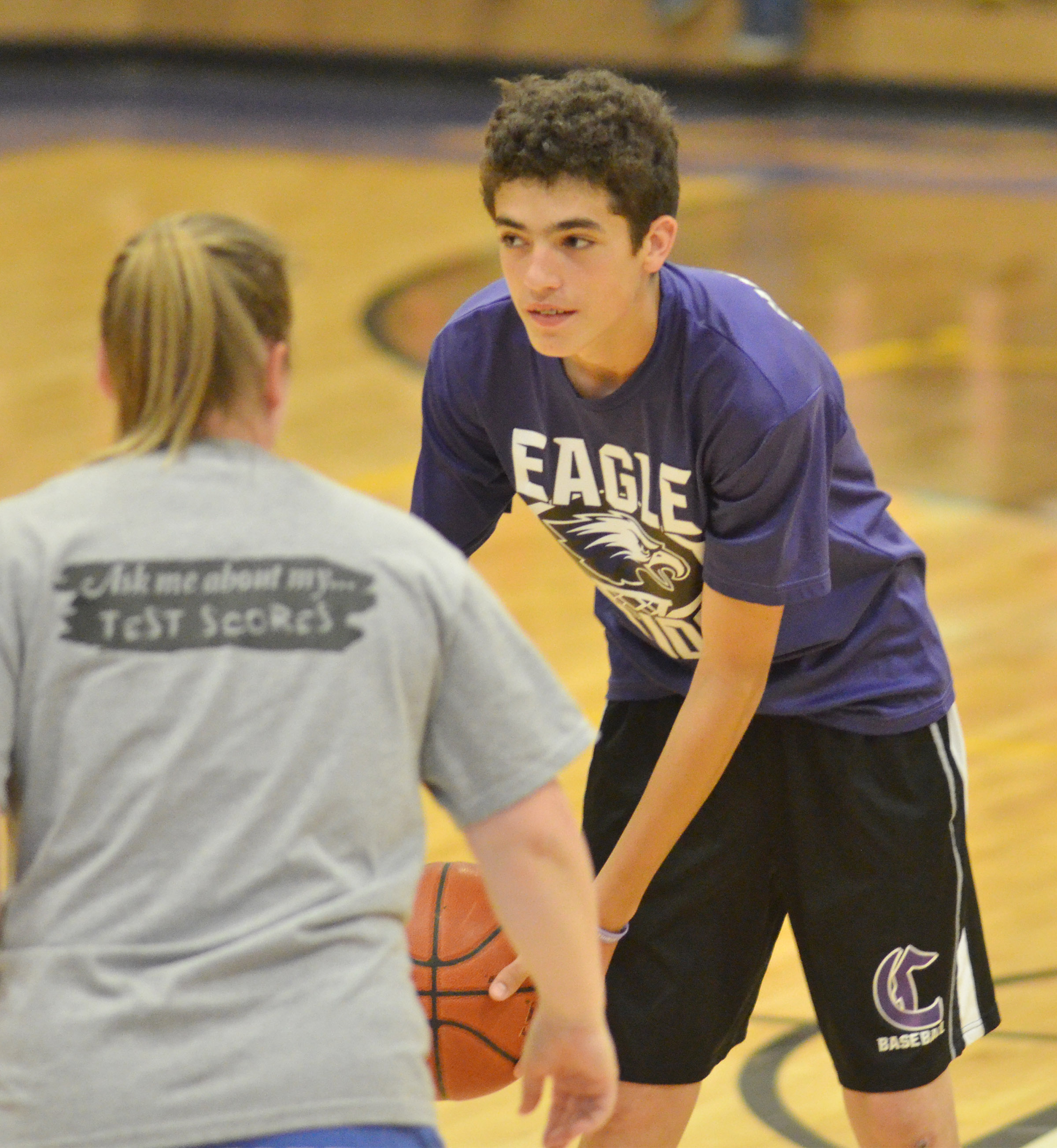 CMS eighth-grader Kameron Smith looks to pass at teacher Katie Campbell guards him.