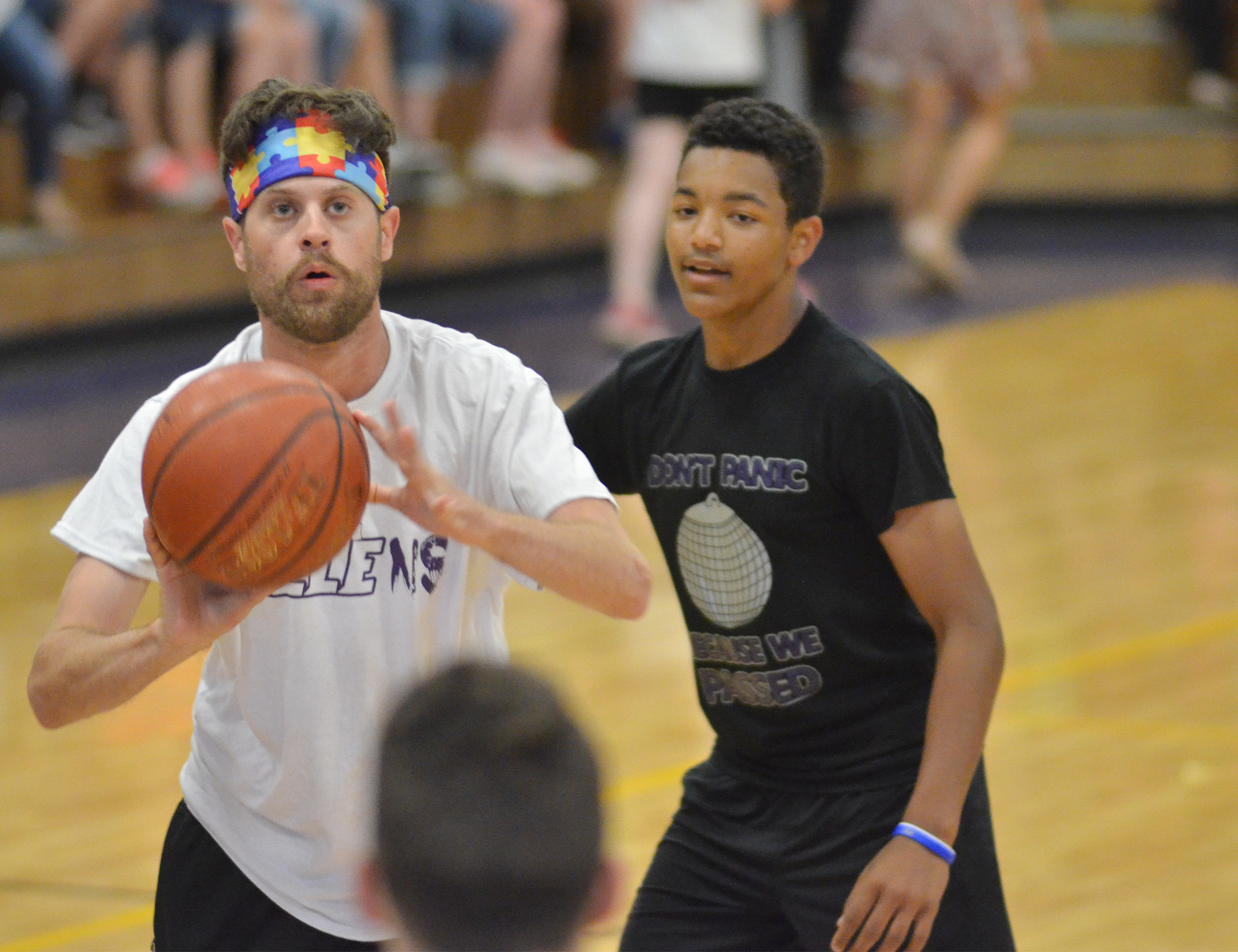 CMS eighth-grader Reggie Thomas guards Campbellsville High School instructional assistant Matthew Schmuck.